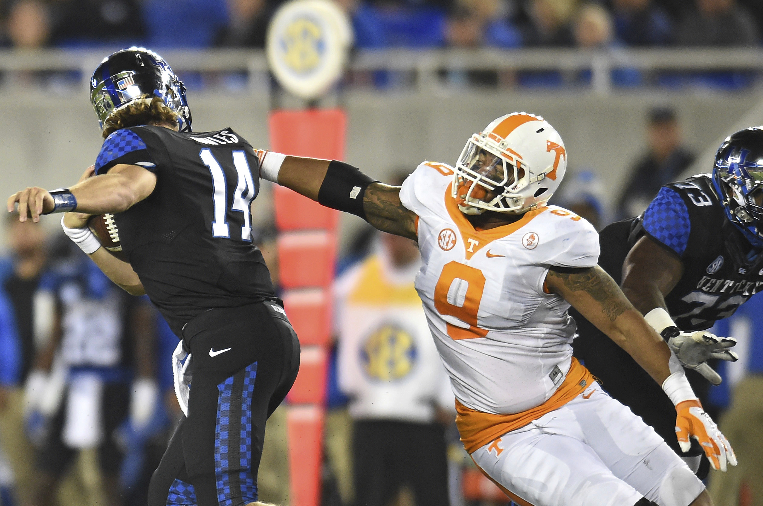 FILE - In this Oct. 31, 2015, file photo, Tennessee defensive end Derek Barnett sacks Kentucky quarterback Patrick Towles, left, during an NCAA college football game in Lexington, Ky. The matchup Saturday, Oct. 8, 2016, between No. 8 Texas A&M and No. 9 T