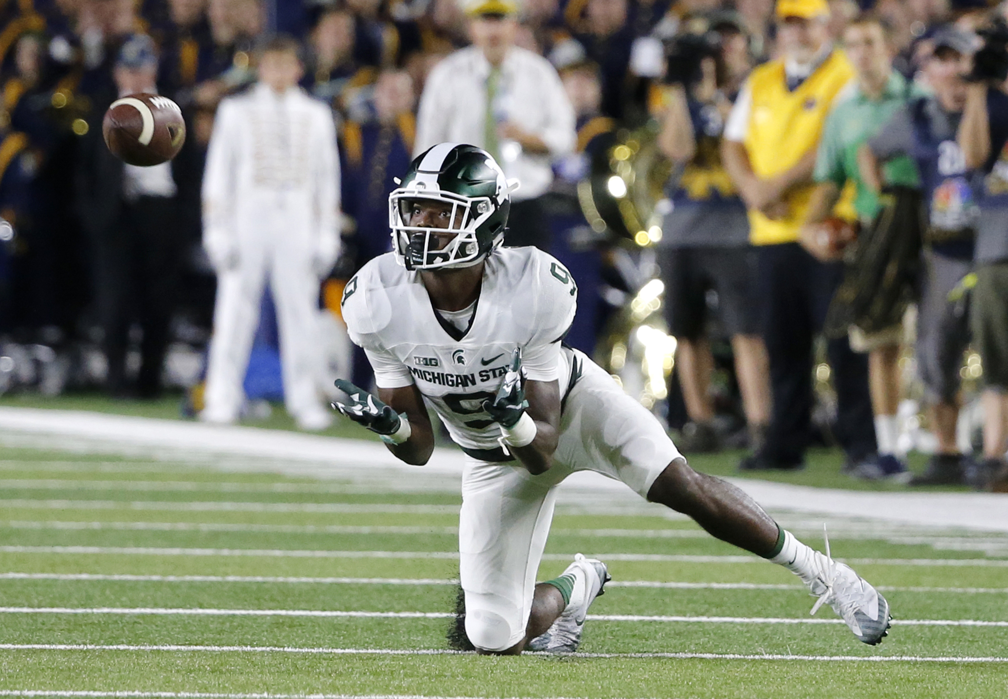 FILE - In this Sept. 17, 2016, file photo, Michigan State wide receiver Donnie Corley caches a pass from quarterback Tyler O'Connor during the closing minutes of an NCAA college football game against Notre Dame, in South Bend, Ind. Corley has become one o
