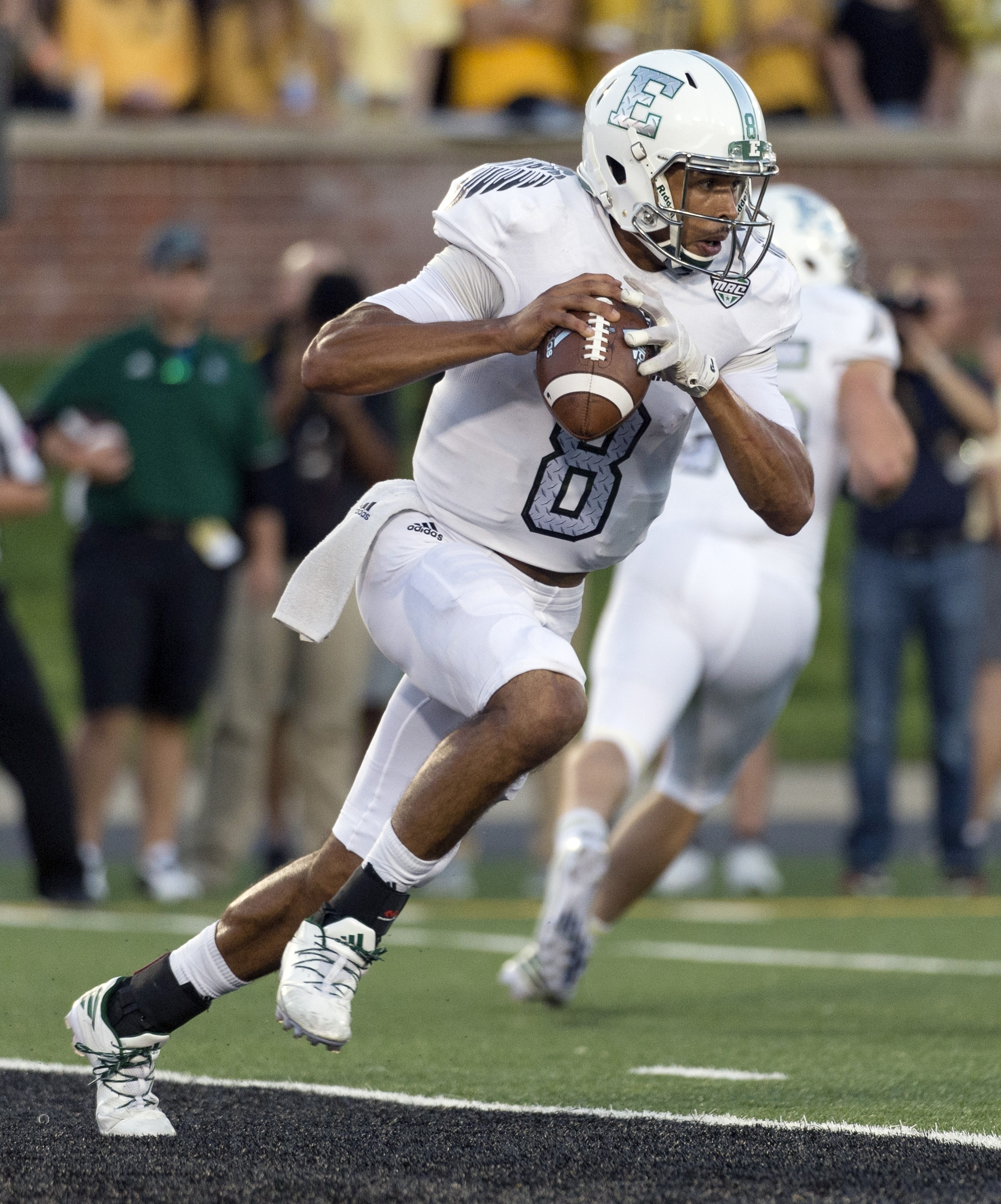 FILE- In this Sept. 10, 2016, file photo, Eastern Michigan quarterback Todd Porter scrambles out of the pocket during the first quarter of an NCAA college football game against Missouri, in Columbia, Mo. After a turbulent offseason in which the school hie
