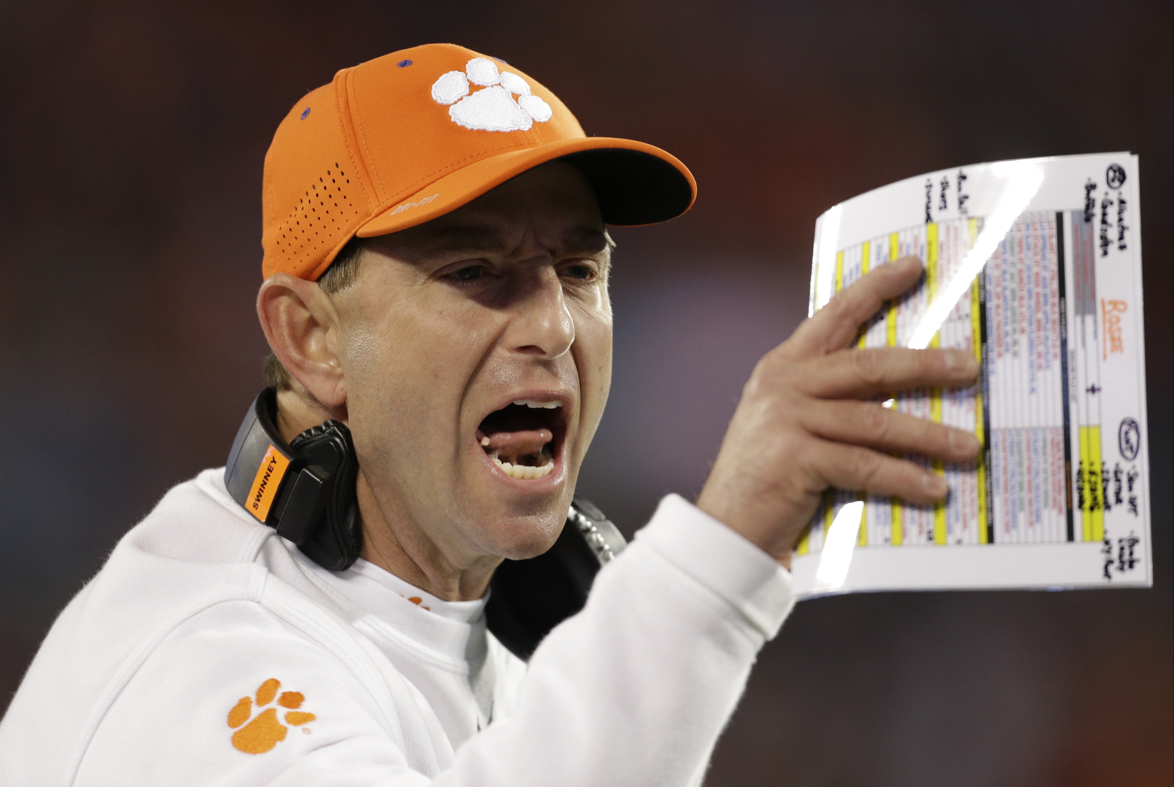 FILE - In this Dec. 5, 2015, file photo, Clemson head coach Dabo Swinney directs his team against North Carolina during the first half of the Atlantic Coast Conference championship NCAA college football game in Charlotte, N.C. Swinney might have to tell h