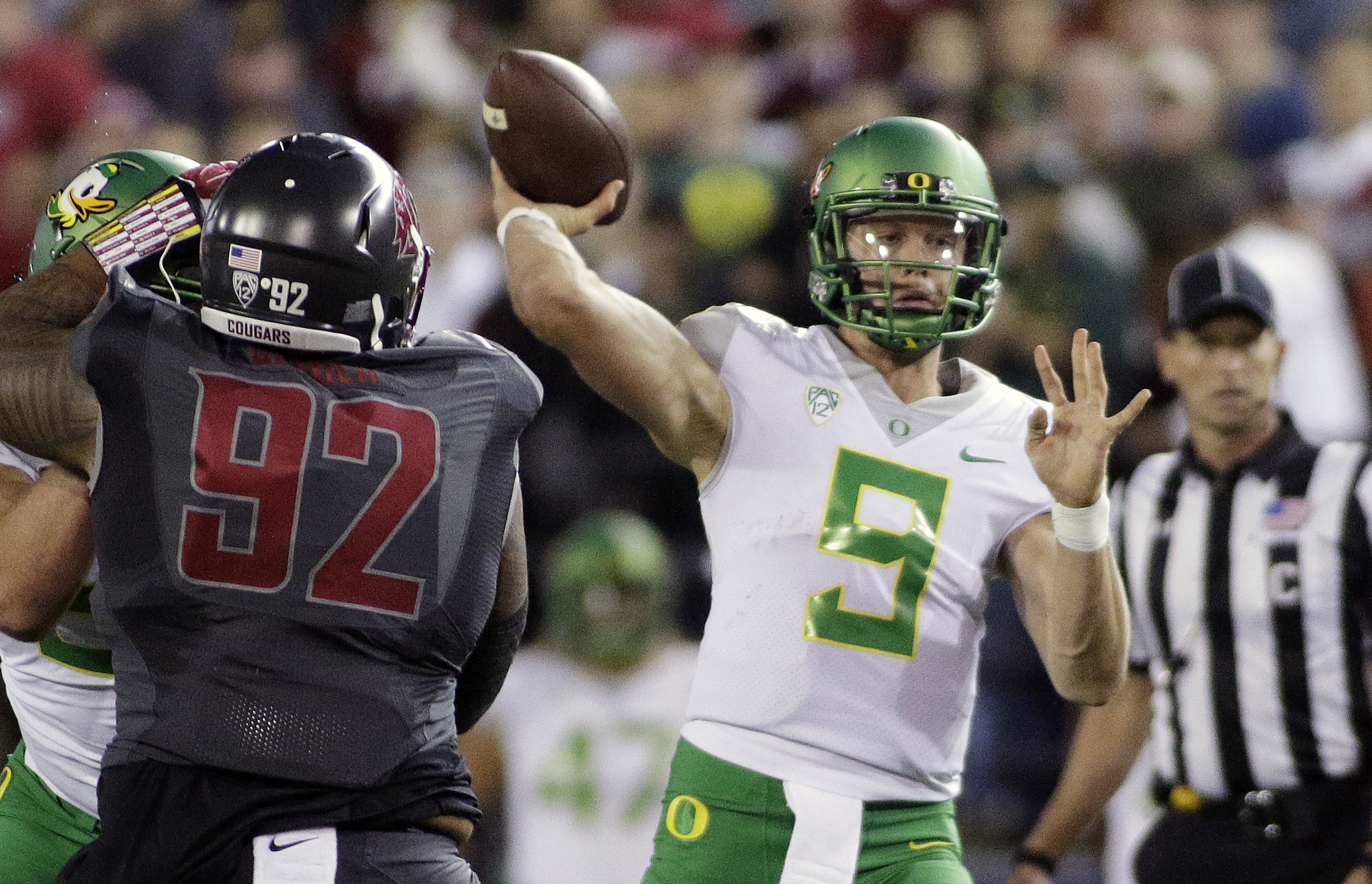FILE - In this Oct. 1, 2016, file photo, Oregon quarterback Dakota Prukop (9) throws a pass during the first half of an NCAA college football game against Washington State in Pullman, Wash. Prukop, a graduate transfer from Montana State, has started in al