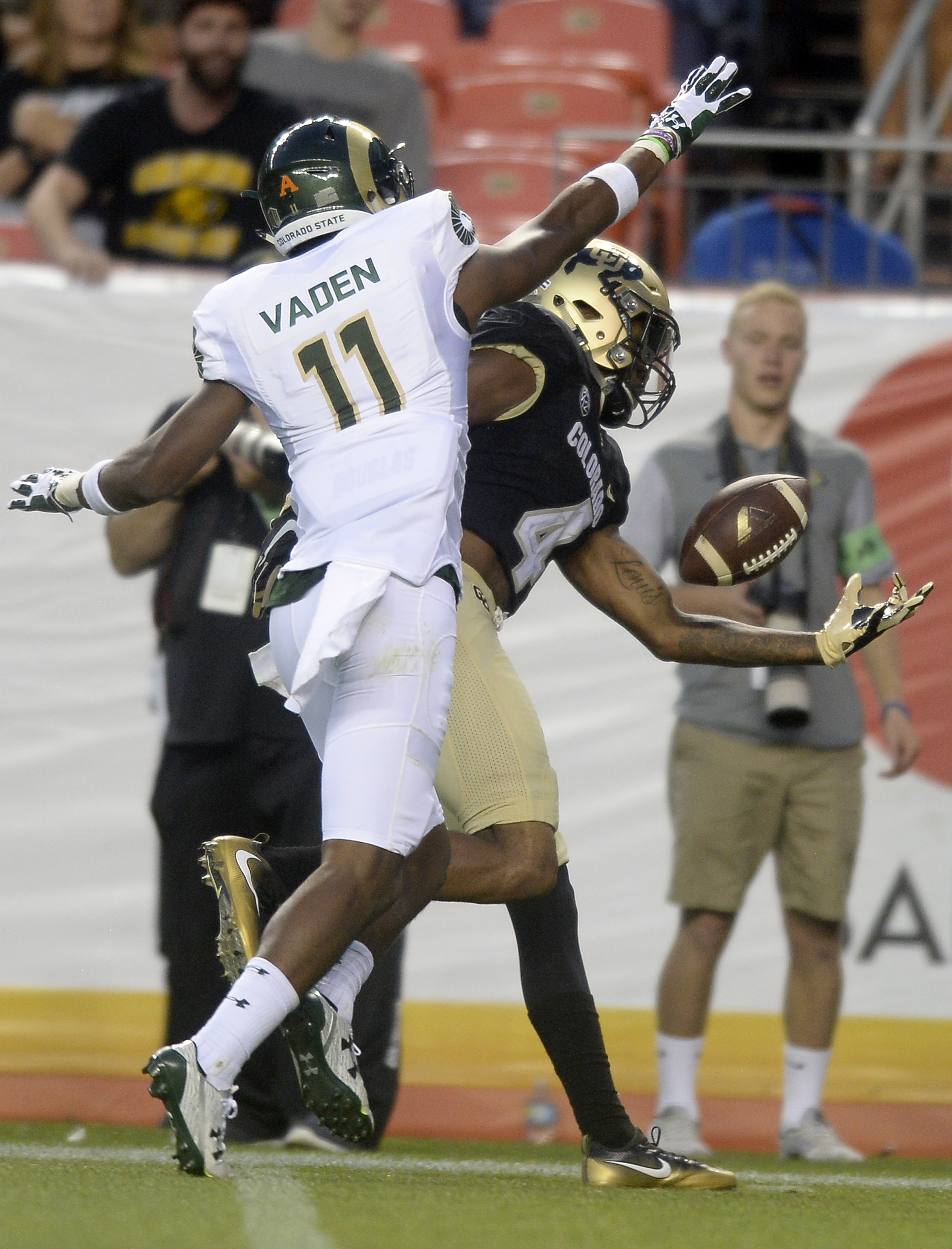 "FILE - In this Sept. 2, 2016, file photo, Colorado's Bryce Bobo makes a one-handed catch against Colorado States's Jordon Vaden during an NCAA college football game in Boulder, Colo. On the inside of his right biceps, Bobo has ""Antonio"" tattooed in cursiv"