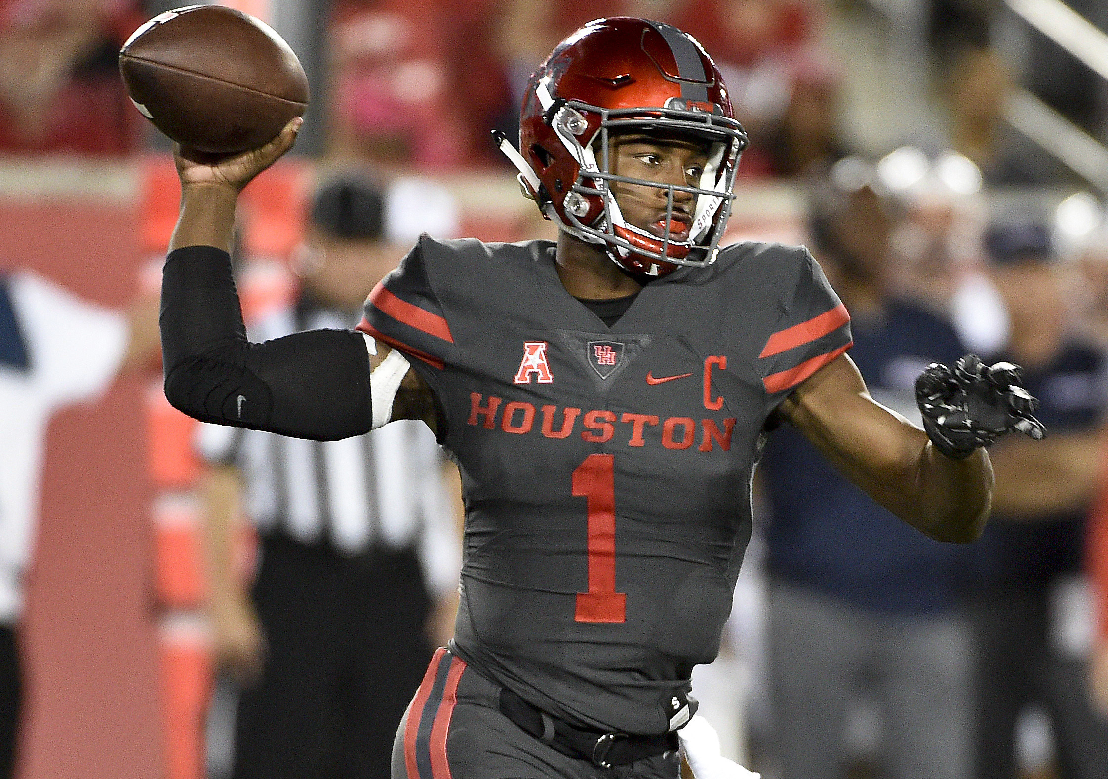 FILE - In this Sept. 29, 2016, file photo, Houston quarterback Greg Ward Jr. throws a pass in the second half of an NCAA college football game against Connecticut, in Houston. Navy head coach Ken Niumatalolo offered a unique strategy when asked his though
