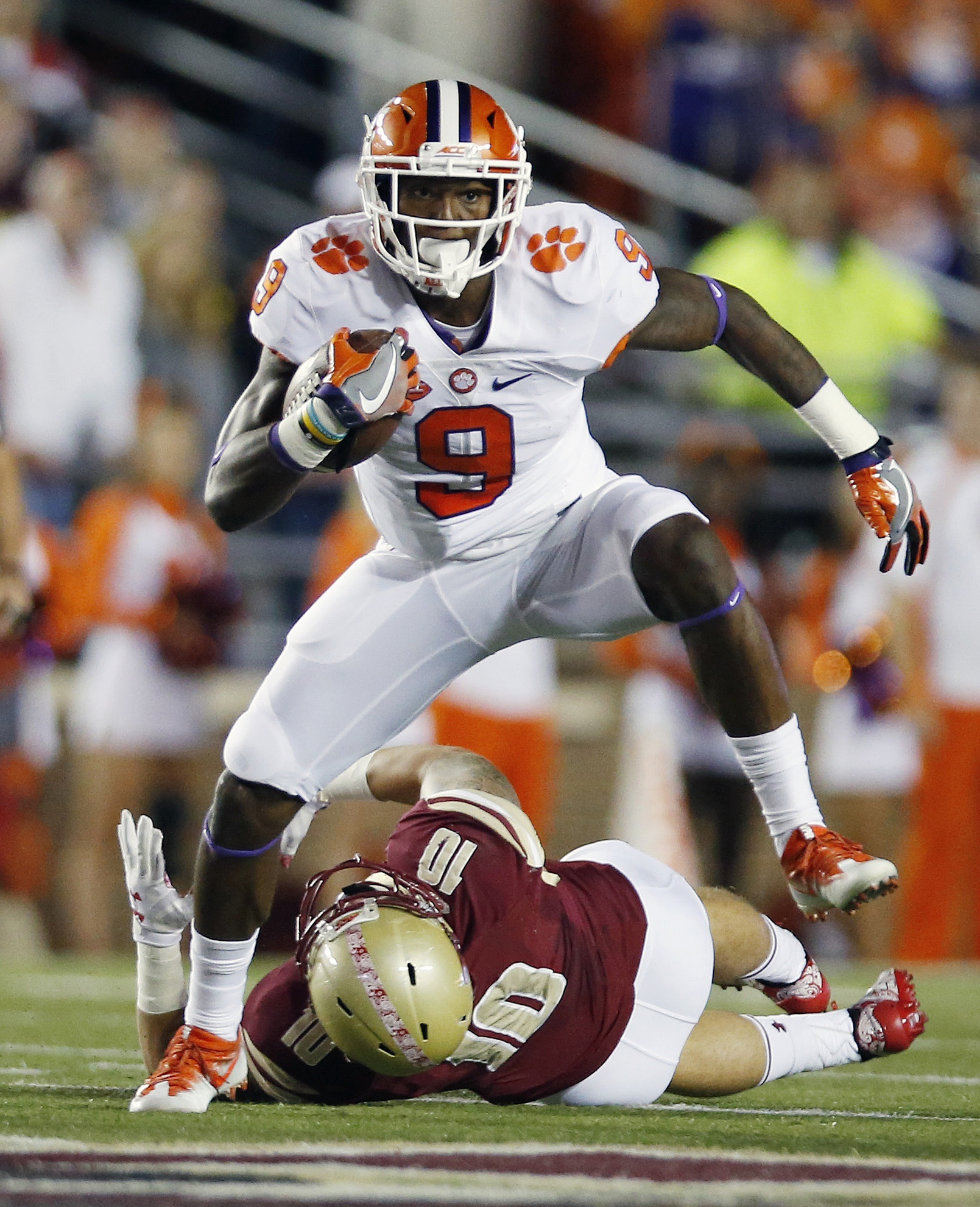 Clemson running back Wayne Gallman (9) gets past Boston College linebacker Ty Schwab (10) on a touchdown run during the first quarter of an NCAA college football game in Boston, Friday, Oct. 7, 2016. (AP Photo/Michael Dwyer)