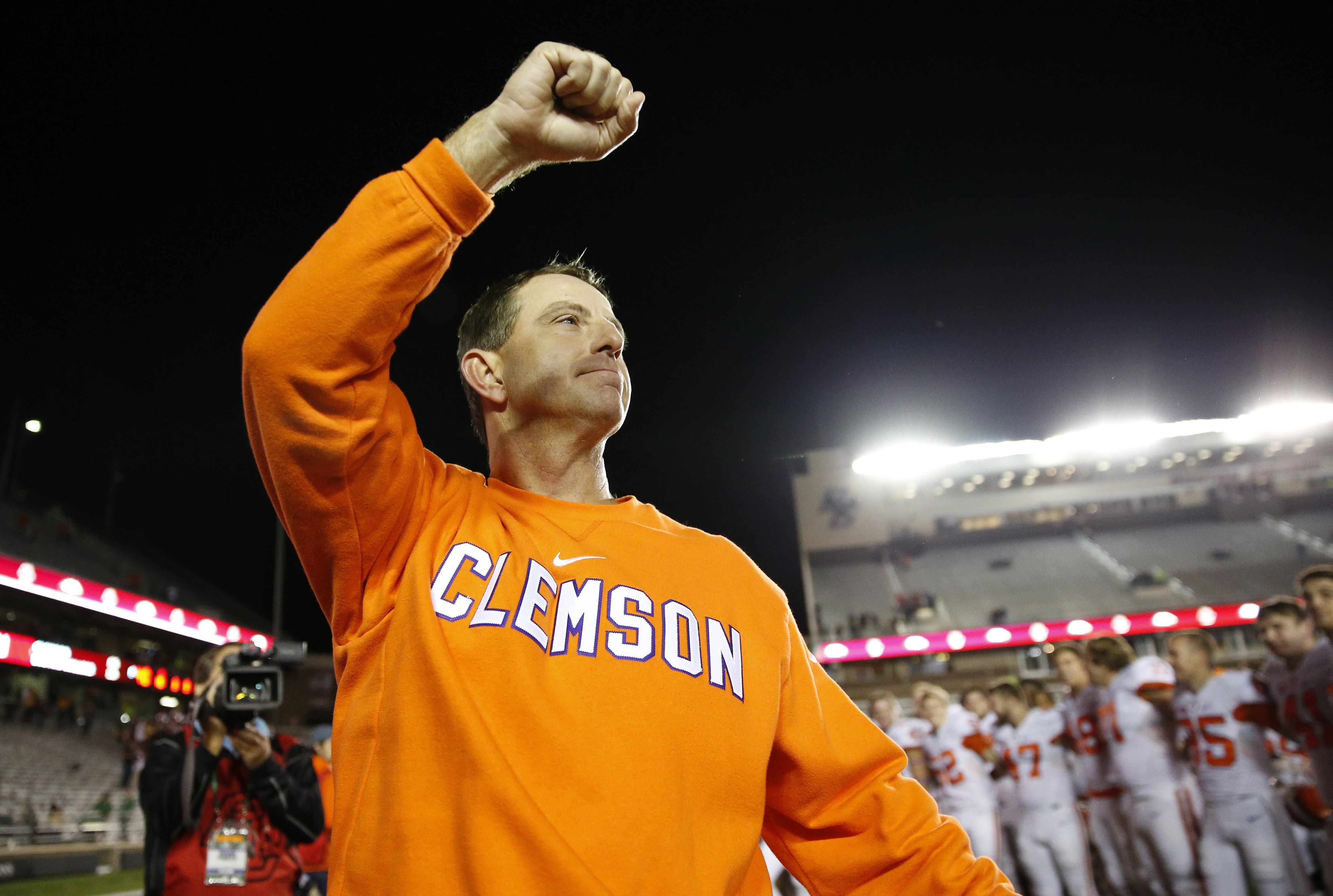Clemson coach Dabo Swinney celebrates after his team defeated Boston College 56-10 in an NCAA football game in Boston, Friday, Oct. 7, 2016. (AP Photo/Michael Dwyer)