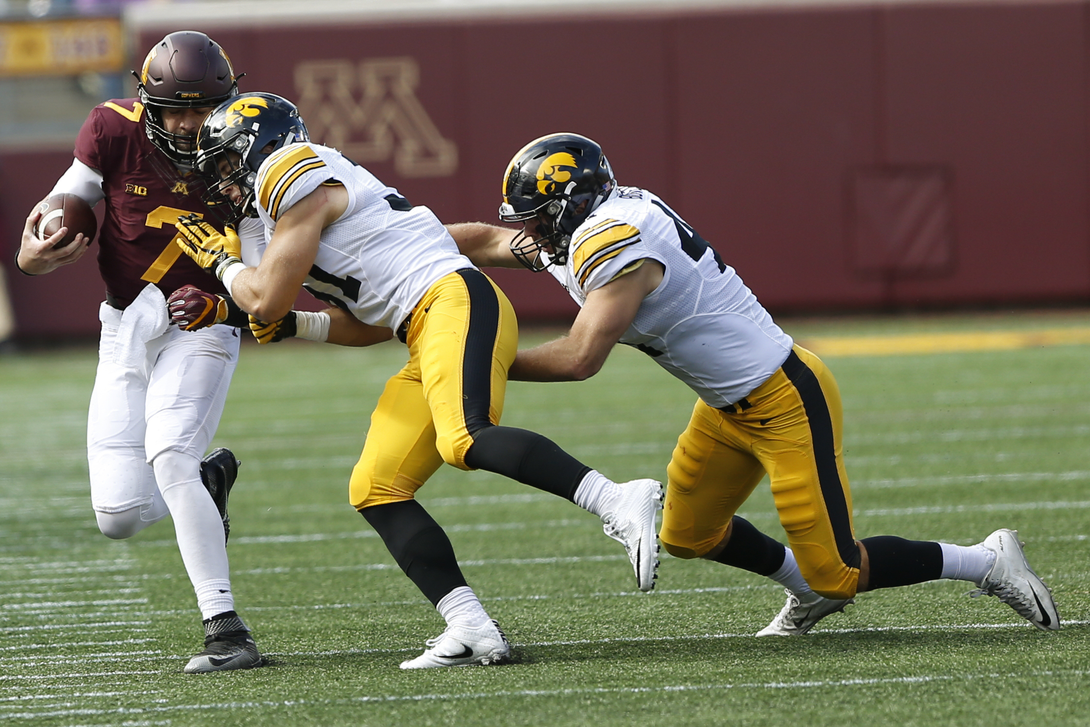 Minnesota quarterback Mitch Leidner (7) is pushed across the field by Iowa linebacker Aaron Mends during an NCAA college football game Saturday, Oct. 8, 2016, in Minneapolis. Iowa won 14-7.(AP Photo/Stacy Bengs)