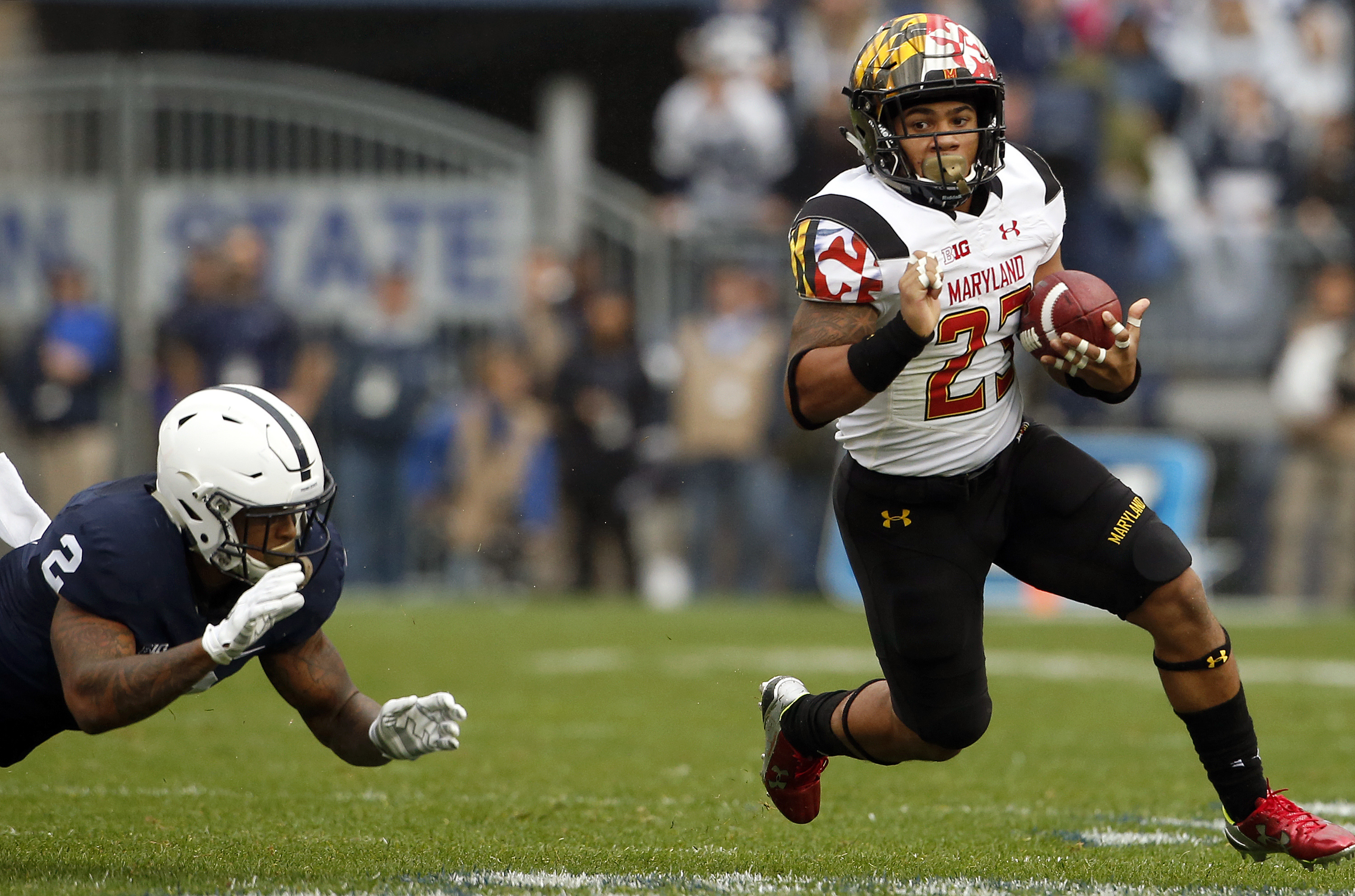 Maryland's Lorenzo Harrison (23) gets past Penn States Marcus Allen (2) during the first half of an NCAA college football game in State College, Pa., Saturday, Oct. 8, 2016. Penn State won the game 38-14. (AP Photo/Chris Knight)