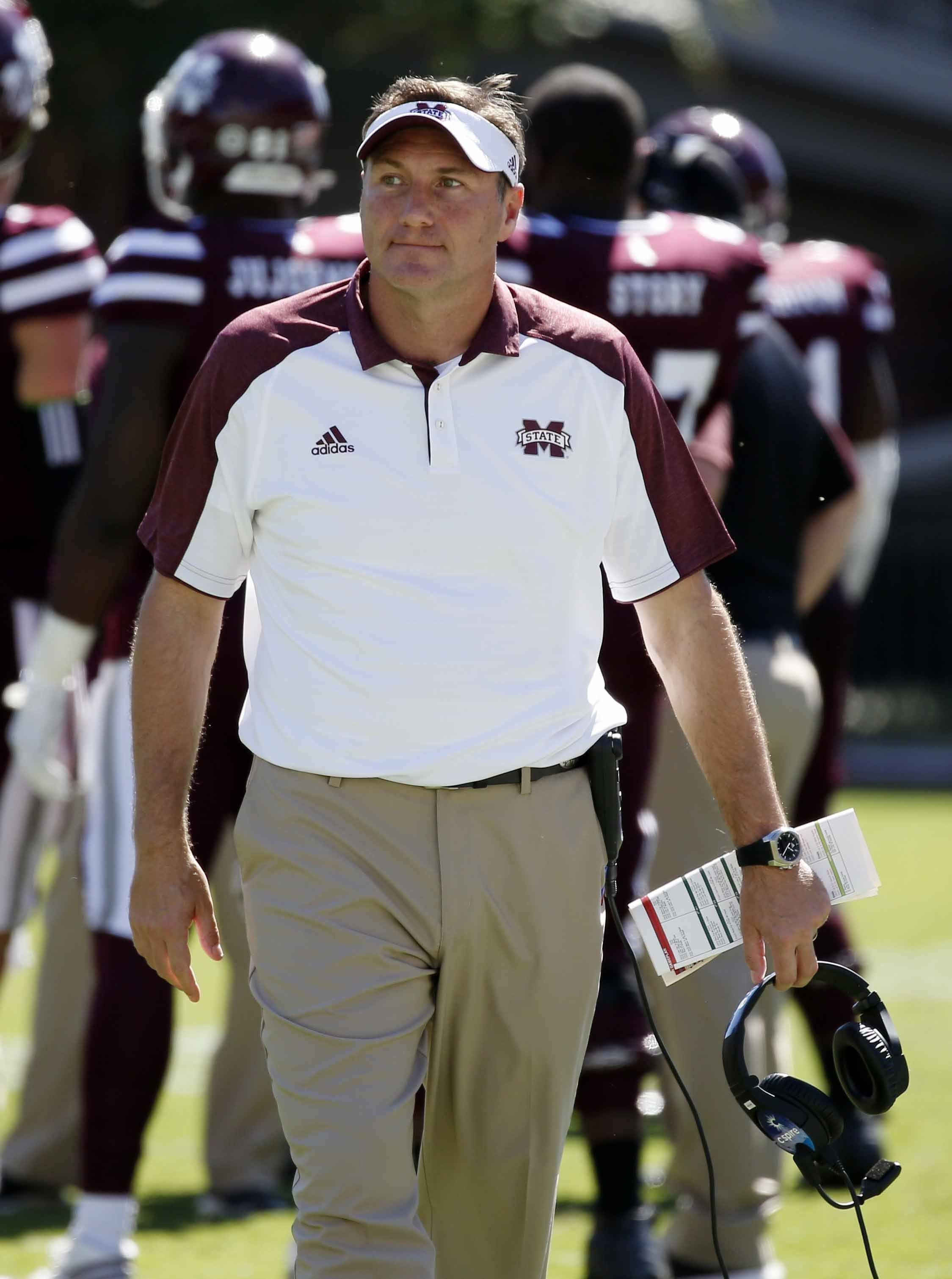 Mississippi State head coach Dan Mullen looks downfield in the second half of an NCAA college football game against Auburn, Saturday, Oct. 8, 2016, in Starkville, Miss. Auburn won 38-14. (AP Photo/Rogelio V. Solis)