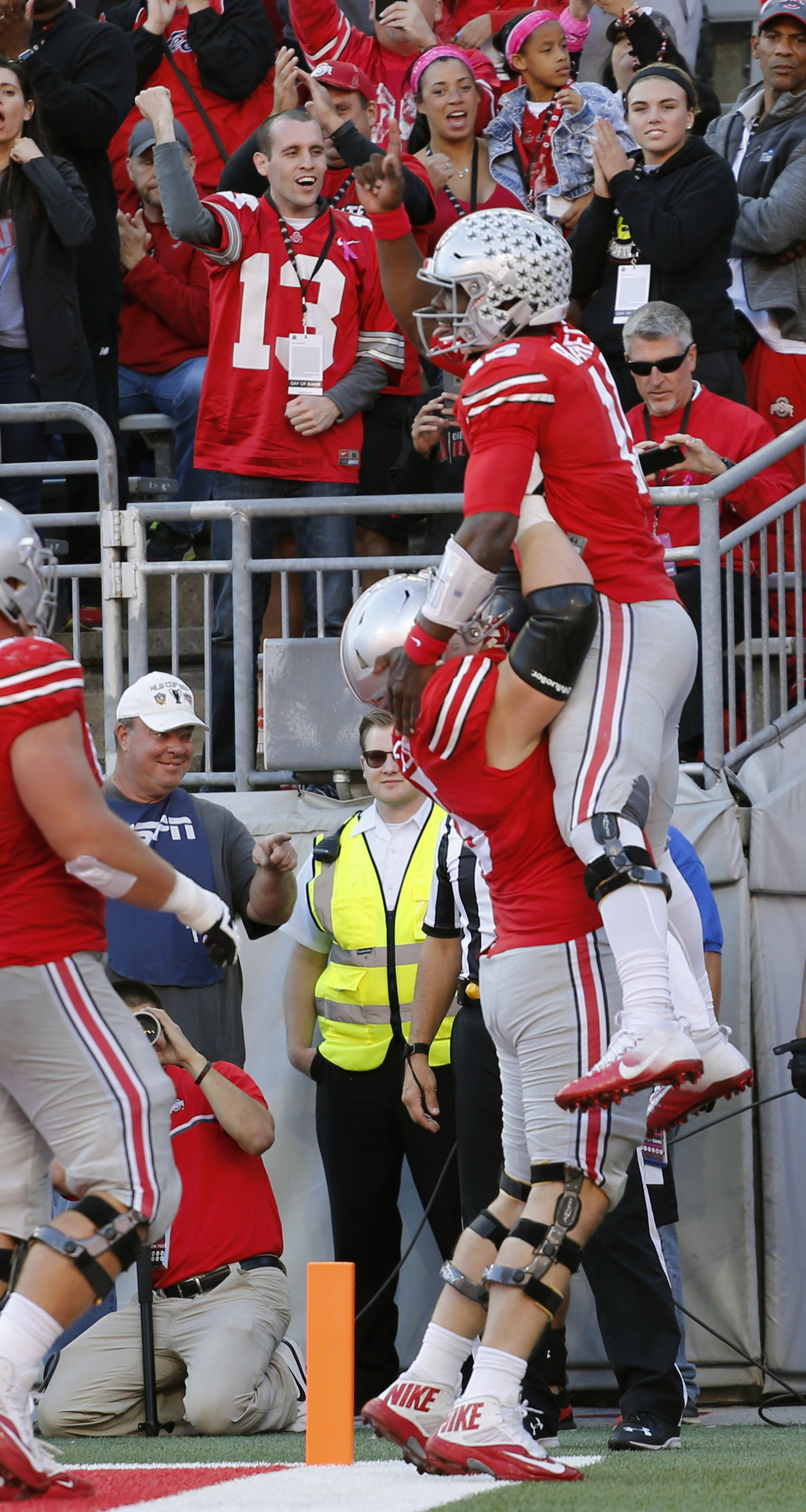 Ohio State quarterback J.T. Barrett, top, celebrates his touchdown against against Indiana with teammate Pat Elflein during the first half of an NCAA college football game Saturday, Oct. 8, 2016, in Columbus, Ohio. (AP Photo/Jay LaPrete)