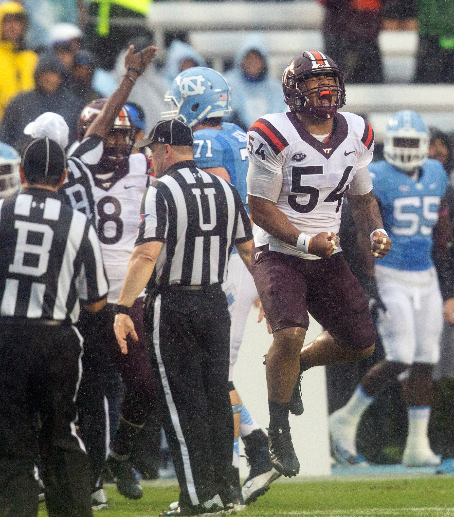 Virginia Tech's Andrew Motuapuaka (54) celebrates following a turnover by North Carolina in the first half of an NCAA college football game Chapel Hill, N.C. Saturday, Oct. 8, 2016. (AP Photo/Ben McKeown)