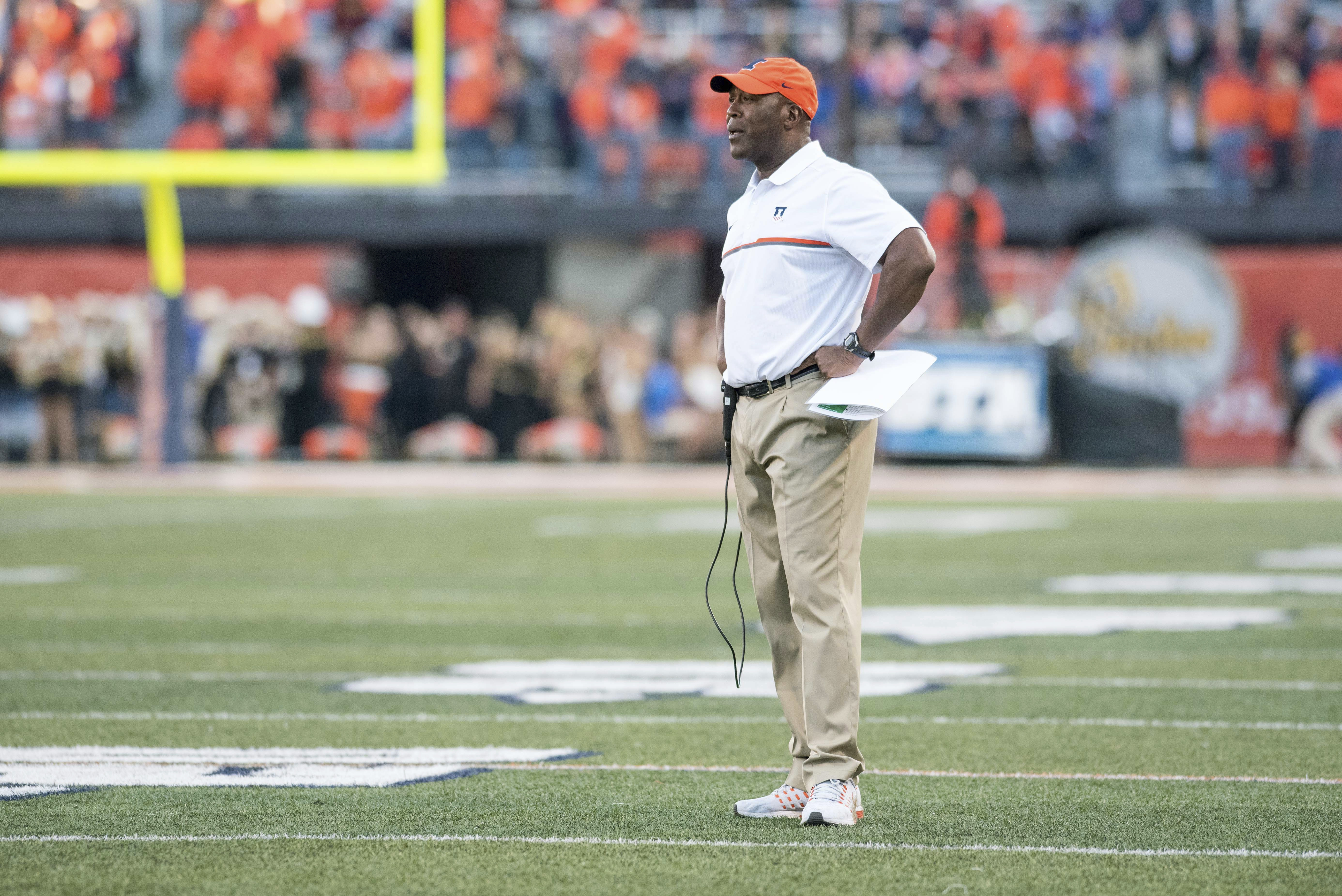 Illinois head coach Lovie Smith stands on the field during a timeout during the second half of an NCAA college football game against Purdue Saturday, Oct. 8, 2016, in Champaign, Ill.  Purdue defeated Illinois 34-31 in overtime.  (AP Photo/Bradley Leeb)