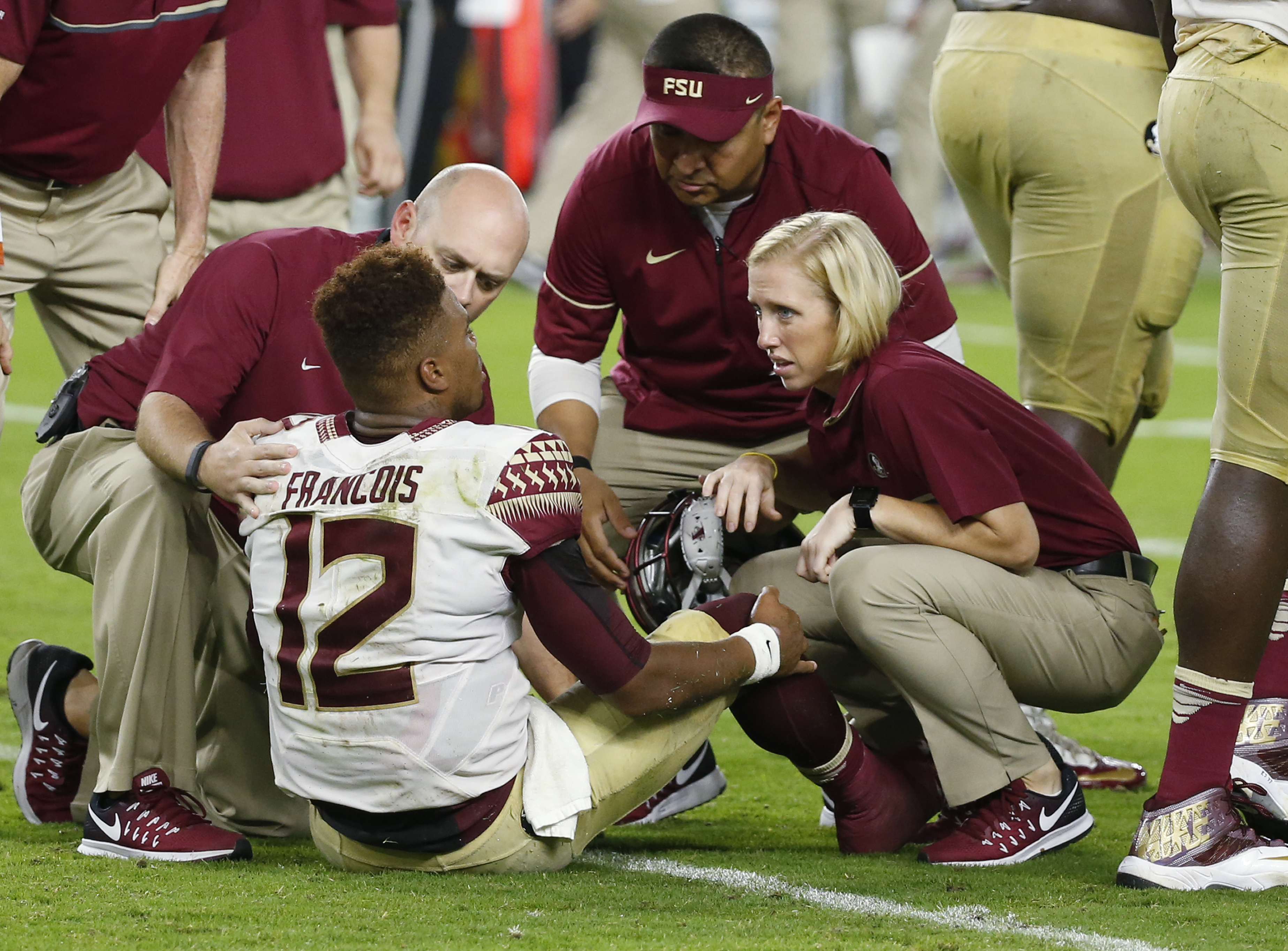 Florida State quarterback Deondre Francois (12) is attended on the field during the second half of an NCAA college football game against Miami, Saturday, Oct. 8, 2016, in Miami Gardens. (AP Photo/Wilfredo Lee)
