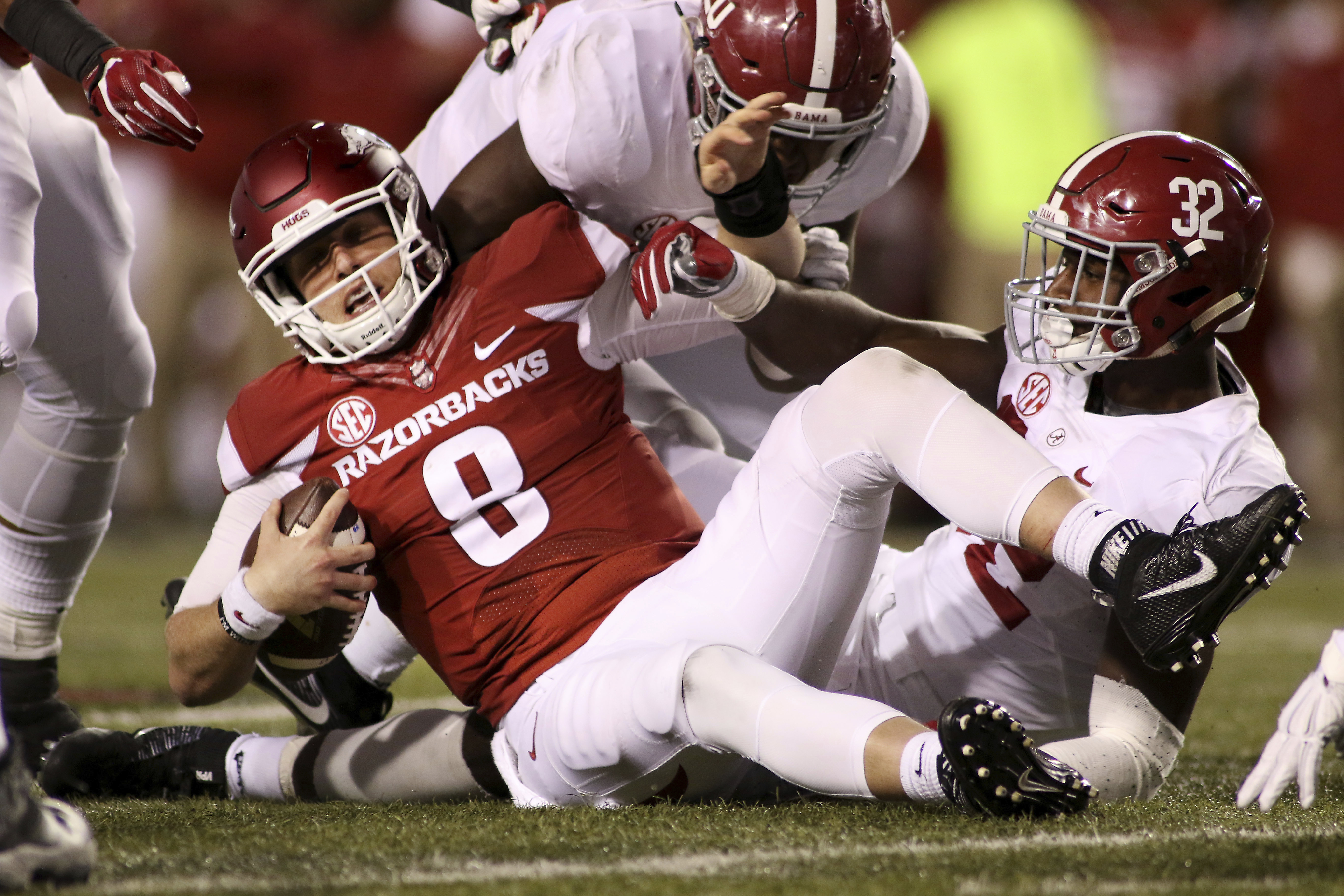 Arkansas' Austin Allen (8) is pulled to the ground by Alabama's Rashaan Evan (32) during the third quarter of an NCAA college football game Saturday, Oct. 8, 2016, in Fayetteville, Ark. Alabama won 49-30. (AP Photo/Samantha Baker)