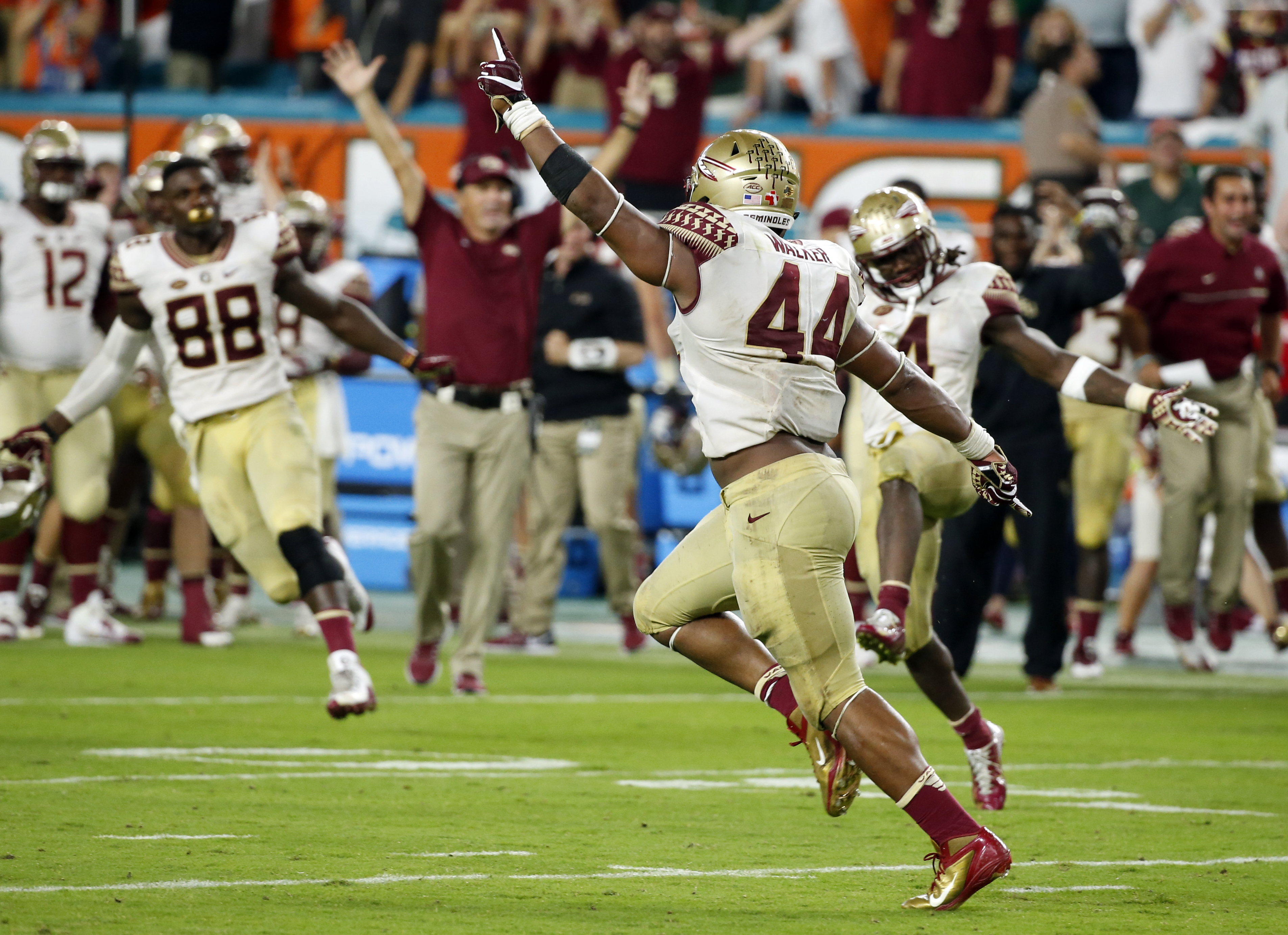Florida State defensive end DeMarcus Walker (44) celebrates after blocking a field goal during the second half of an NCAA college football game against Miami, Saturday, Oct. 8, 2016, in Miami Gardens. Florida State defeated Miami 201-19. (AP Photo/Wilfred