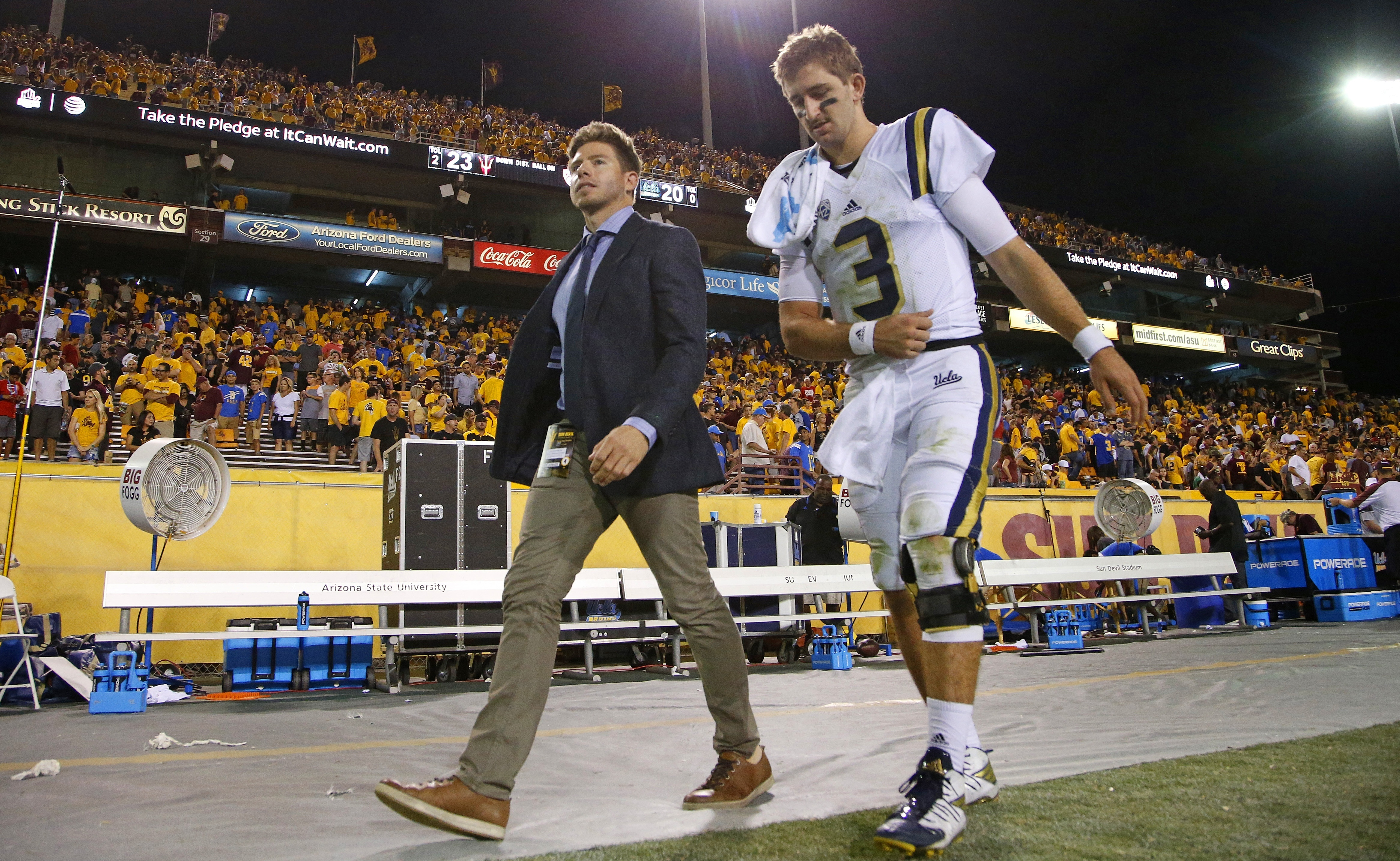 UCLA quarterback Josh Rosen (3) limps off the field after an NCAA college football game against Arizona State Saturday, Oct. 8, 2016, in Tempe, Ariz.  Arizona State defeated UCLA 23-20. (AP Photo/Ross D. Franklin)