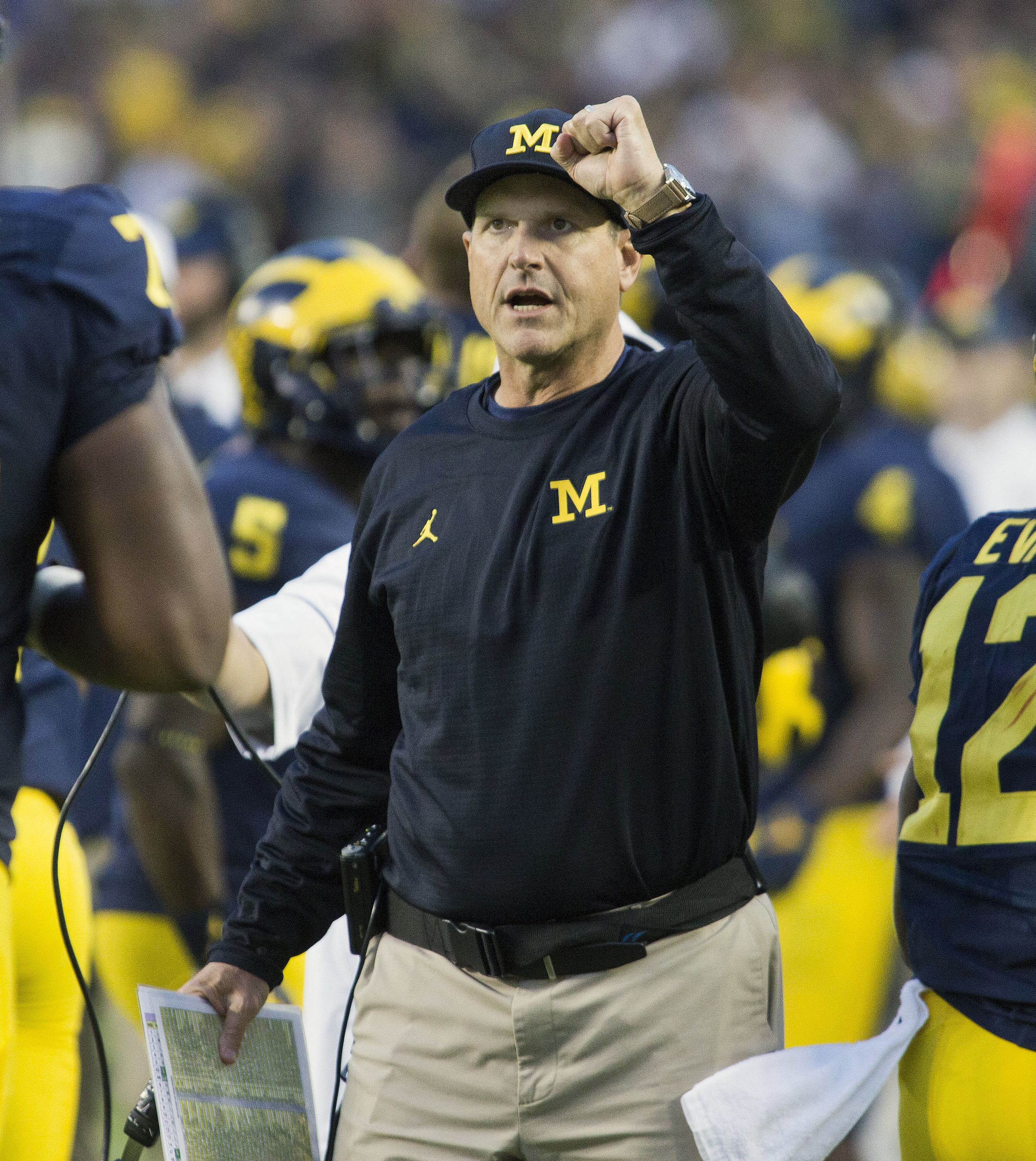 FILE - In this Oct. 1, 2016, file photo, Michigan head coach Jim Harbaugh cheers on his players after a Michigan touchdown in the fourth quarter of an NCAA college football game against Wisconsin at Michigan Stadium in Ann Arbor, Mich. Clearly, No. 2 Ohio