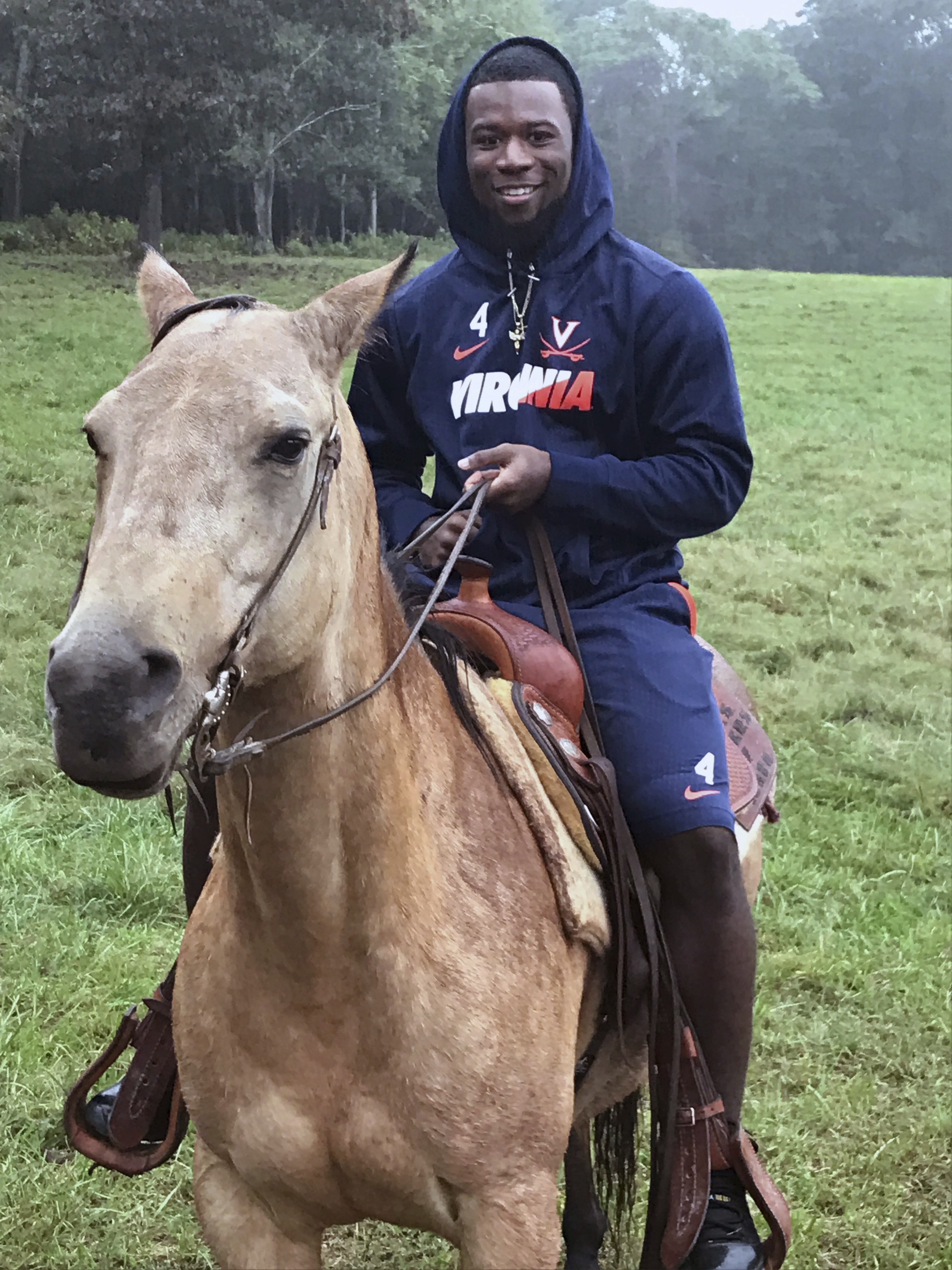 This photo provided by Jack McDonald shows University of Virginia football player Taquan Mizzell riding a horse at Virginia head coach Bronco Mendenhall's ranch in Charlottesville, Va., Saturday, Oct. 8, 2016. Virginia had a bye week with intense practice