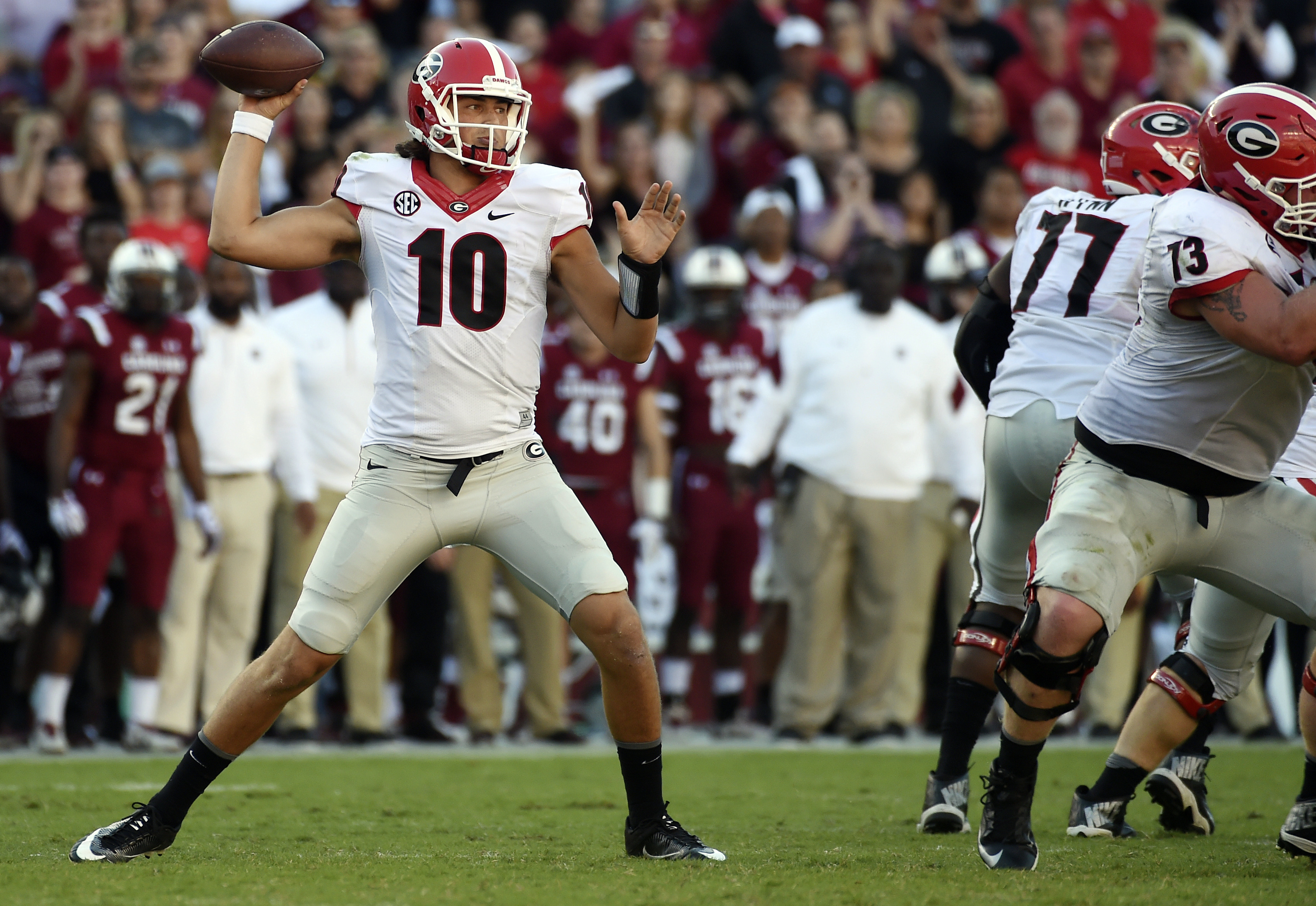 FILE - In this Sunday, Oct. 9, 2016, file photo, Georgia quarterback Jacob Eason (10) throws against South Carolina during the second half of an NCAA college football game in Columbia, S.C. Eason looks very much like a freshman quarterback. He passed for