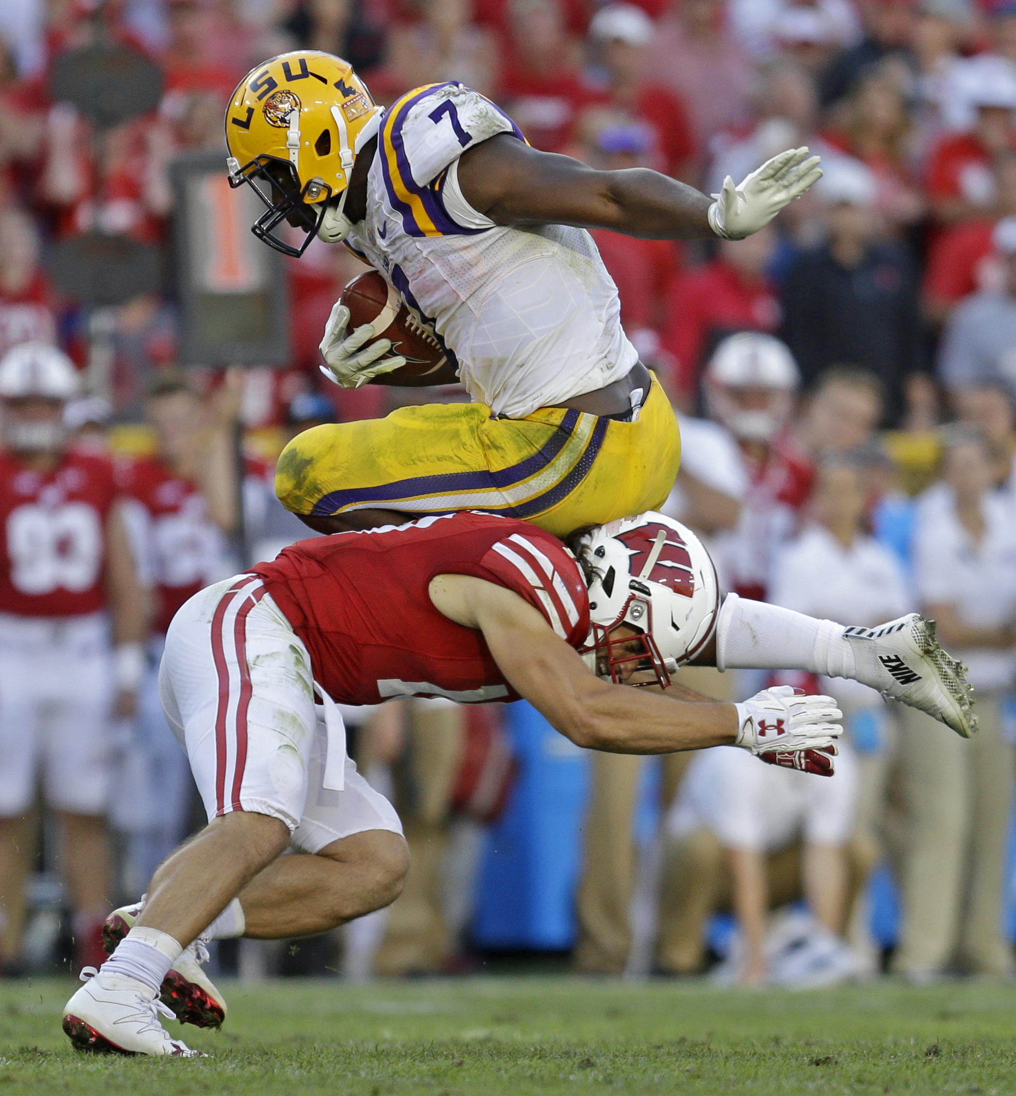 FILE - In this Sept. 3, 2016, file photo, LSU's Leonard Fournette is tackled by Wisconsin's Leo Musso during an NCAA college football game in Green Bay, Wis. The Southeastern Conference, which already made history by winning seven consecutive national cha