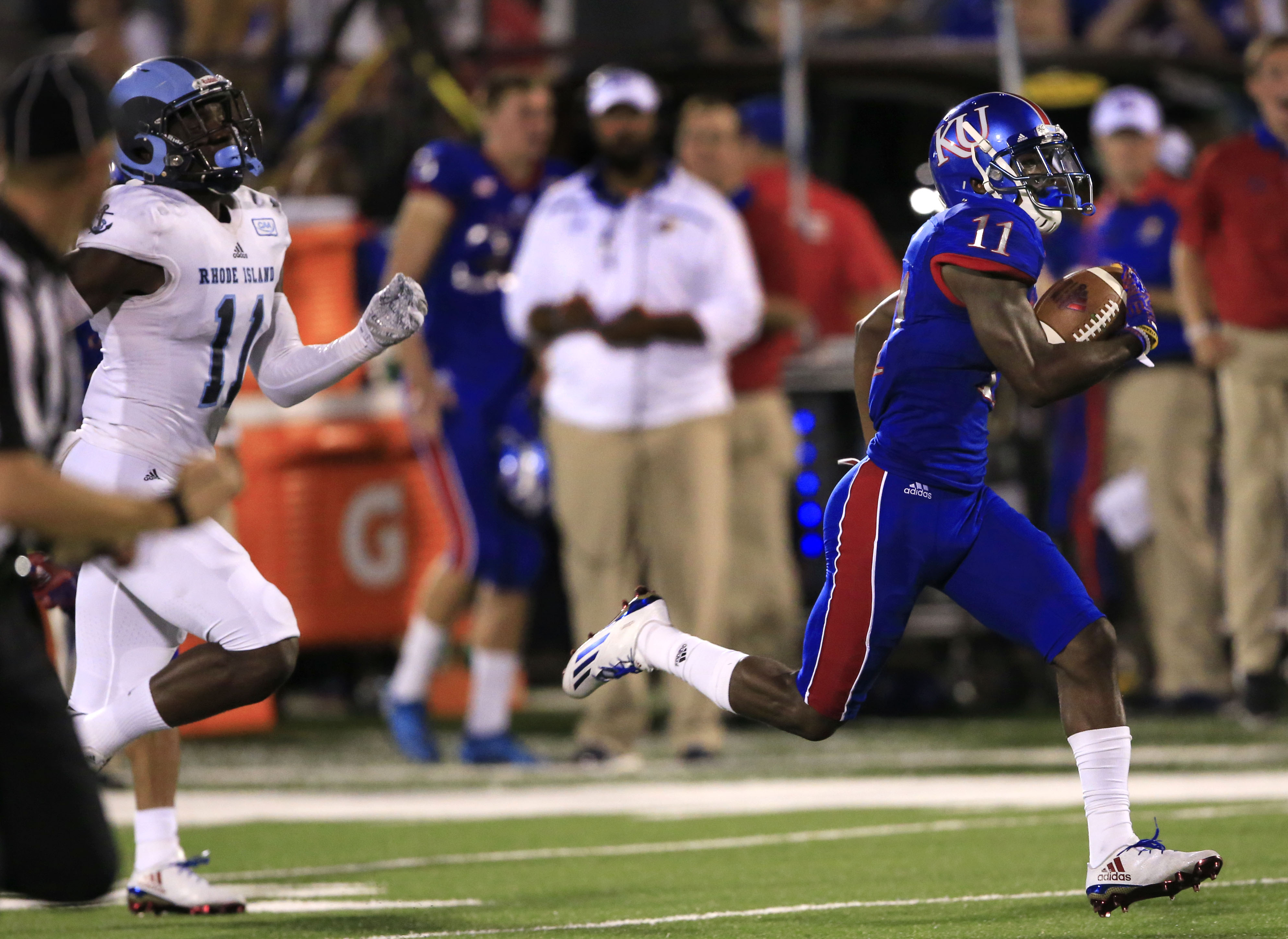 FILE - In this Sept. 3, 2016, file photo, Kansas wide receiver Steven Sims Jr. (11) runs for a touchdown past Rhode Island defensive back D.J. Stewart (11) during the second half of an NCAA college football game in Lawrence, Kan. Kansas is still trying to