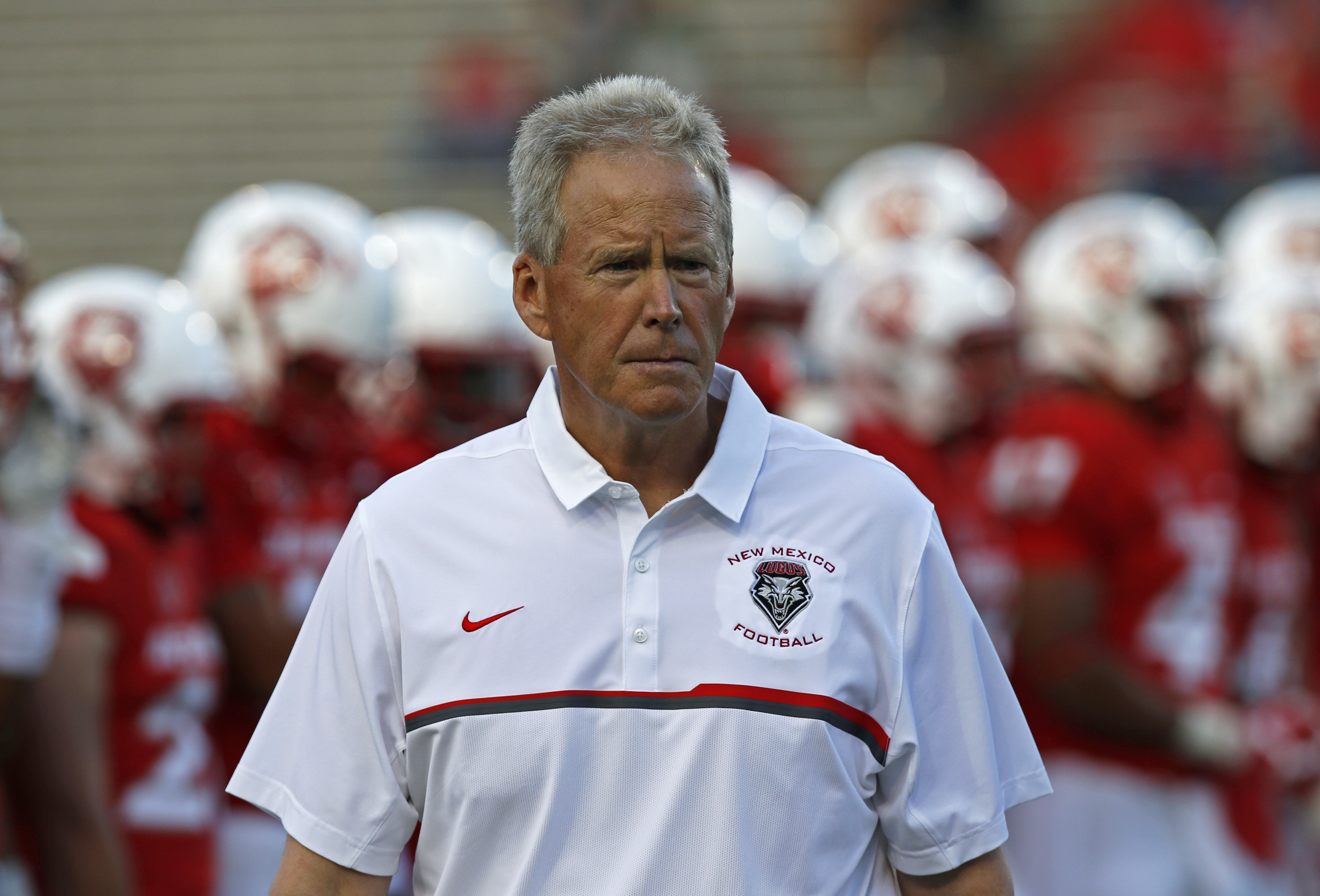 FILE - In this Sept. 1, 2016, file photo, New Mexico coach Bob Davie watches players warm up for the team's NCAA college football game against South Dakota in Albuquerque, N.M. New Mexico faces Air Force on Saturday in Dallas. (AP Photo/Andres Leighton, F