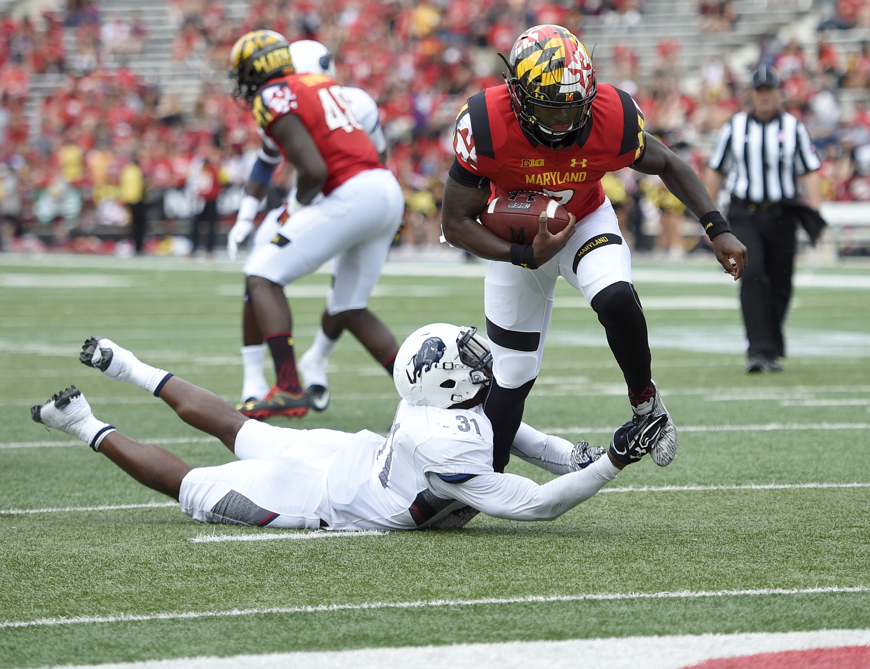 FILE - In this Sept. 3, 2016, file photo, Maryland quarterback Tyrrell Pigrome, right, runs past Howard linebacker David Lee (31) on the way to a touchdown during an NCAA football game in College Park, Md. Perry Hills was injured in Maryland's 38-14 loss