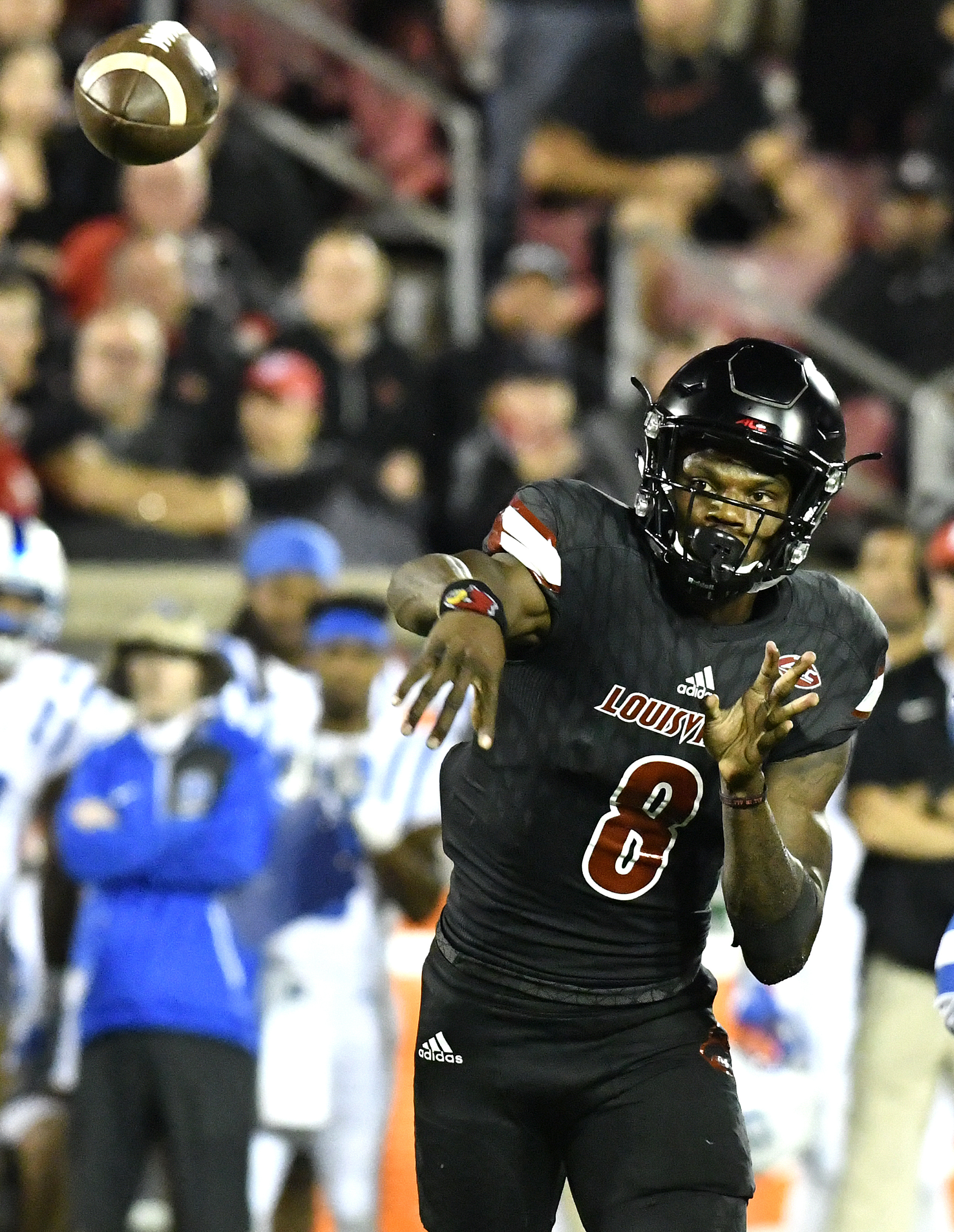 Louisville quarterback Lamar Jackson (8) attempts a pass against the Duke defense during the second half of an NCAA college football game, Friday, Oct. 14, 2016, in Louisville, Ky. (AP Photo/Timothy D. Easley)