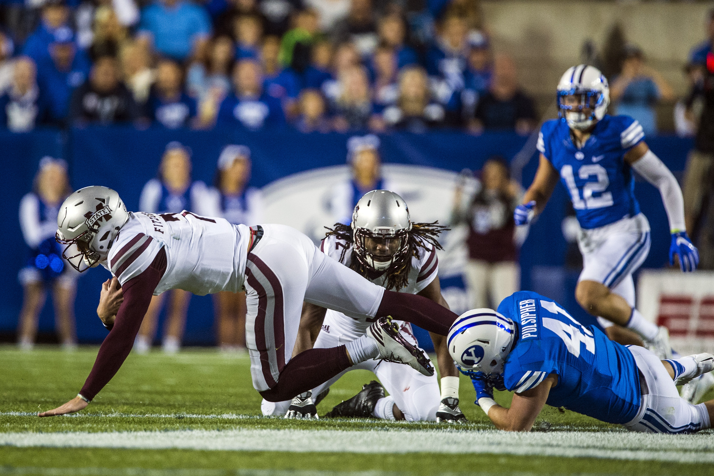 BYU linebacker Adam Pulsipher (41) sacks Mississippi State quarterback Nick Fitzgerald (7) during an NCAA college football game in Provo, Utah, Friday, Oct. 14, 2016. (Chris Detrick/The Salt Lake Tribune via AP)