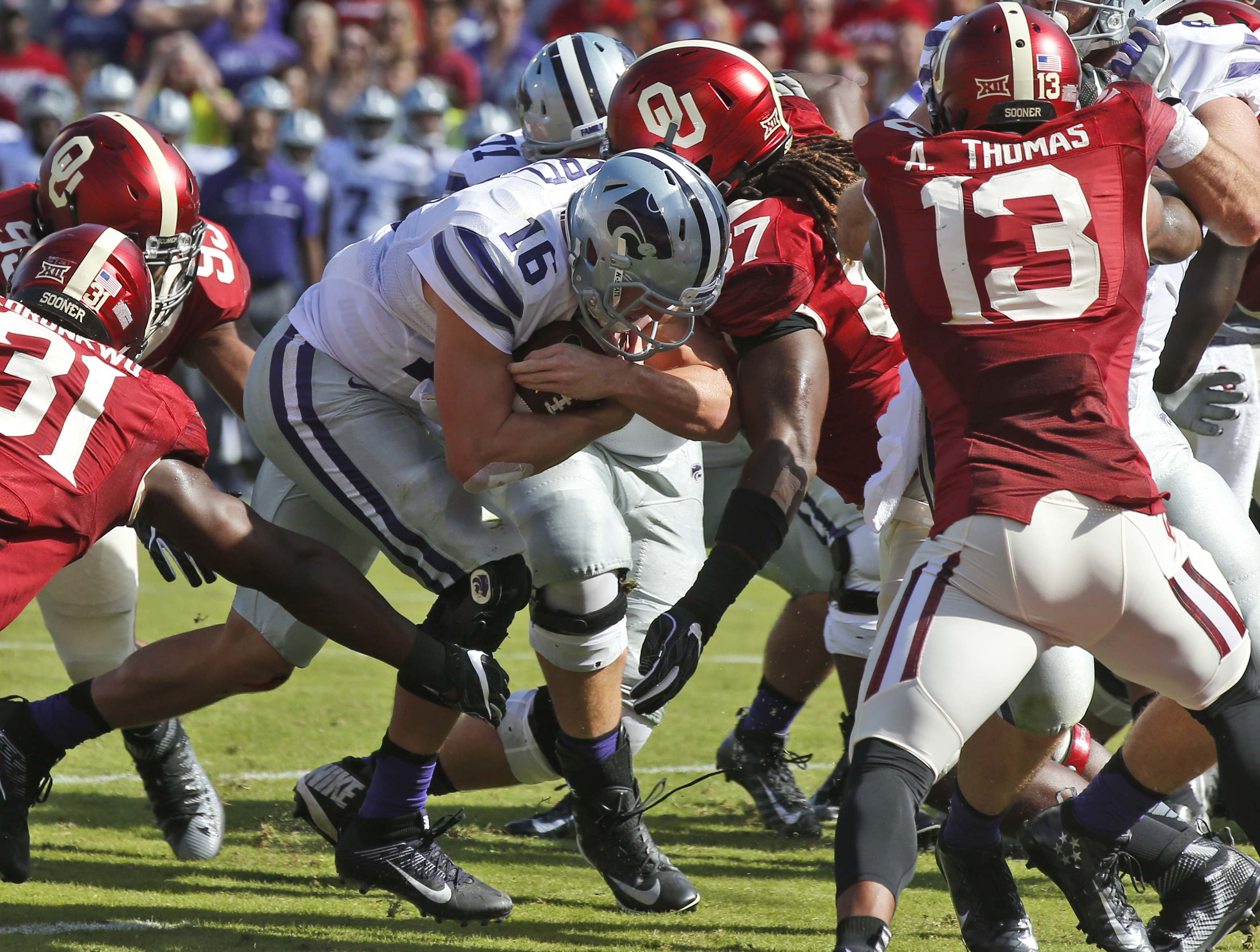 Kansas State quarterback Jesse Ertz (16) pushes through the Oklahoma defense for a touchdown in the second quarter of an NCAA college football game in Norman, Okla., Saturday, Oct. 15, 2016. (AP Photo/Sue Ogrocki)