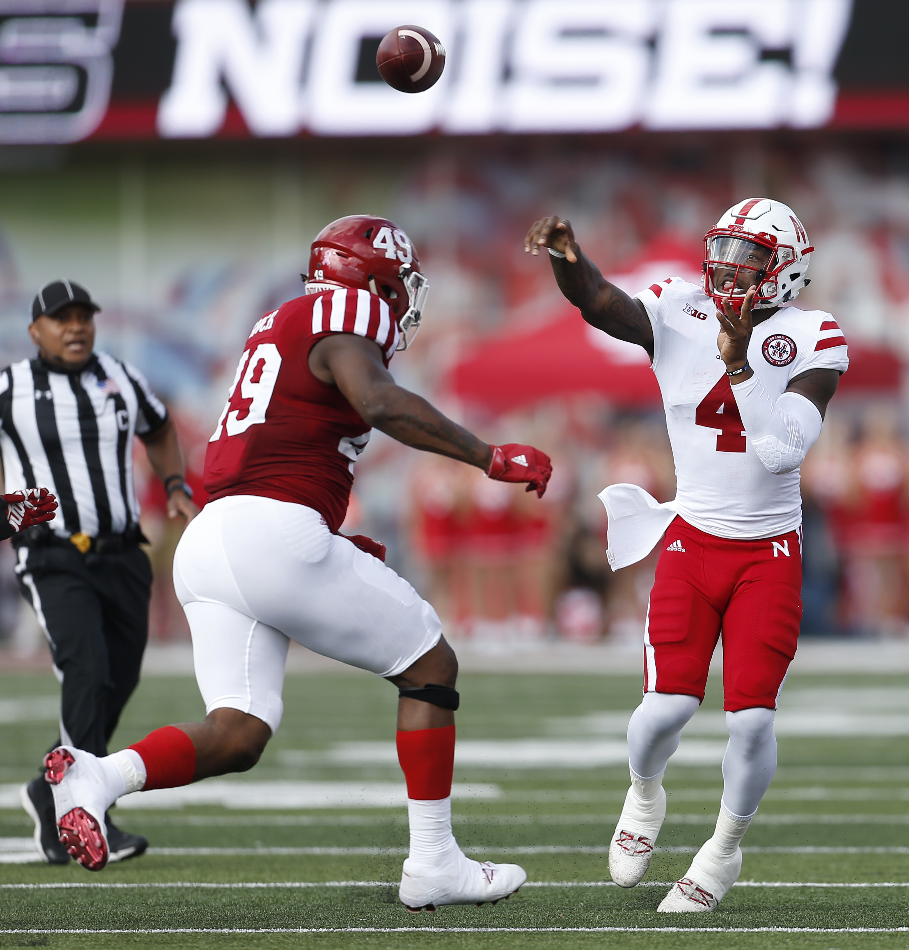 Nebraska quarterback Tommy Armstrong Jr. (4) throws under pressure from Indiana defensive lineman Greg Gooch (49) during the first half of an NCAA college football game in Bloomington, Ind., Saturday, Oct. 15, 2016. (AP Photo/Sam Riche)