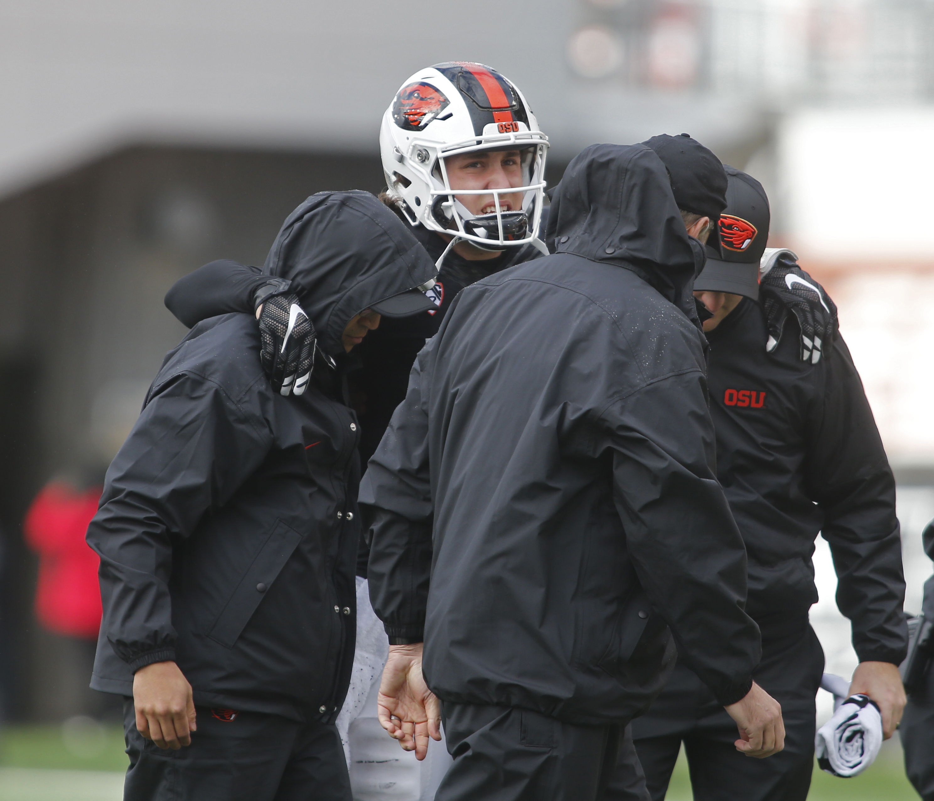 Oregon State starting quarterback Darell Garretson, center, is helped off the field after suffering an injury in the second half of an NCAA college football game against Utah, in Corvallis, Ore., on Saturday, Oct. 15, 2016. Utah won 19-14. (AP Photo/Timot