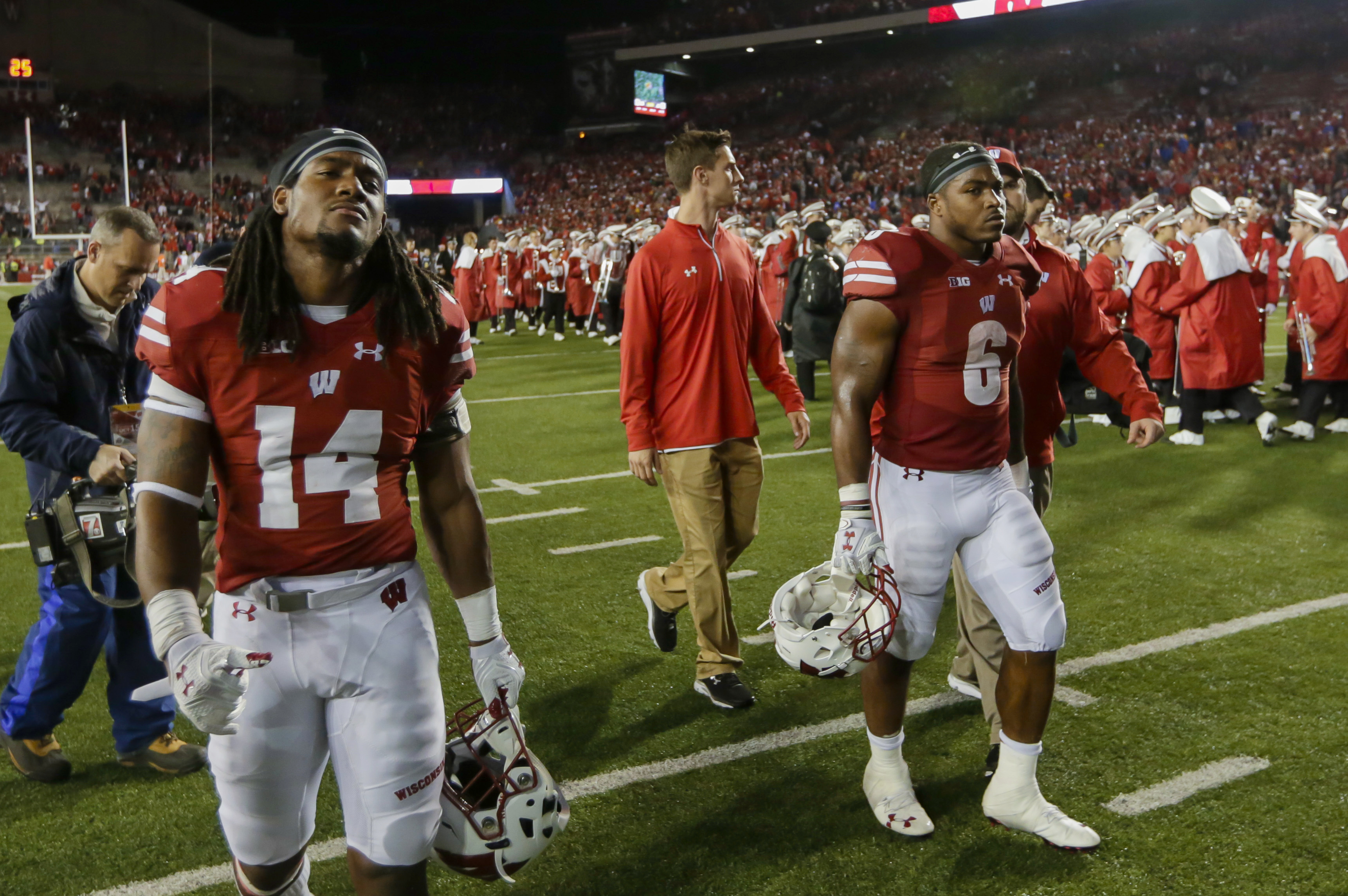 Wisconsin's D'Cota Dixon (14) and Corey Clement (6) walk off the field after Wisconsin lost 30-23 to Ohio State in overtime of an NCAA college football game Saturday, Oct. 15, 2016, in Madison, Wis. Ohio State won 30-23. (AP Photo/Andy Manis)