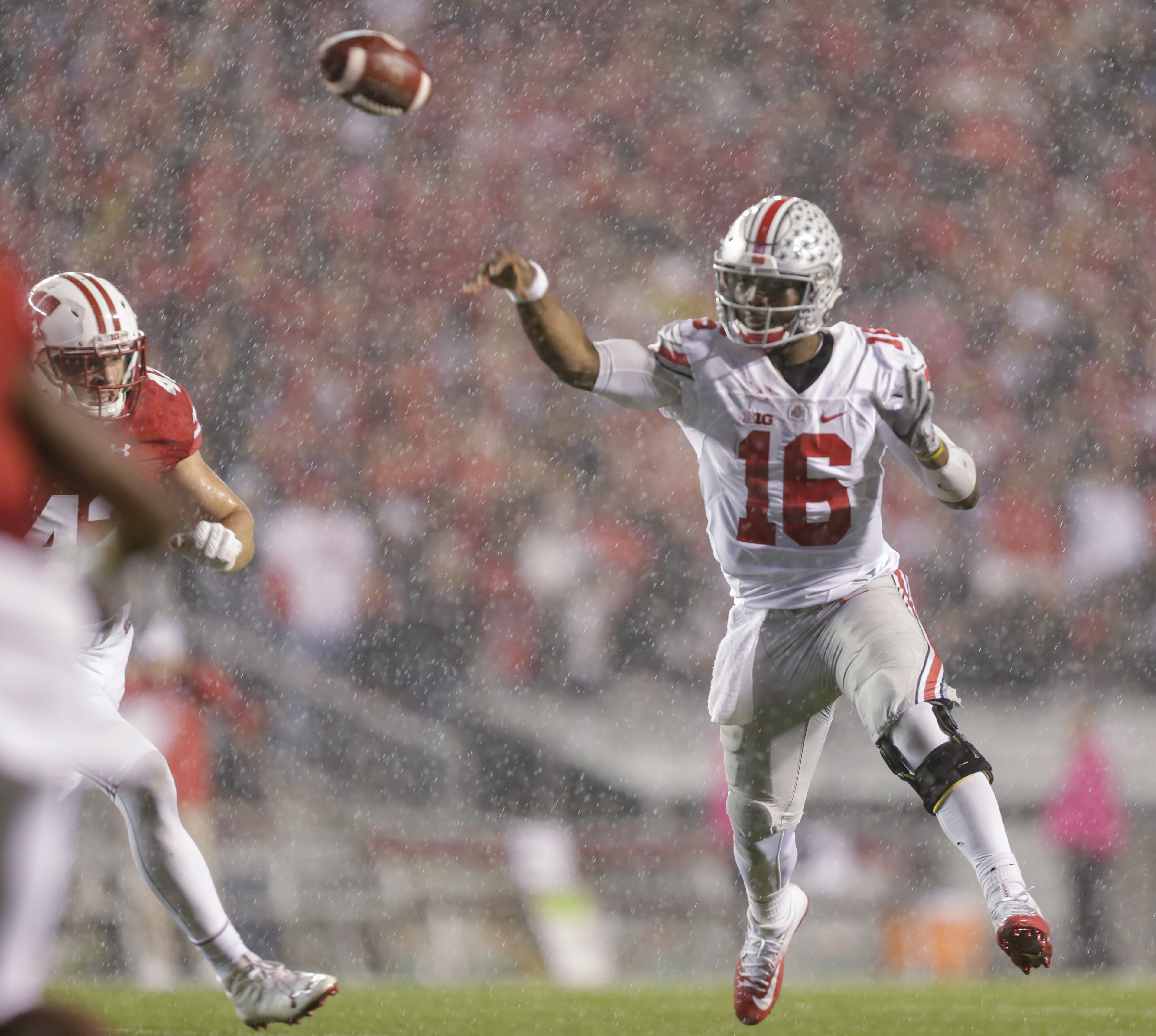 Ohio State quarterback J.T. Barrett passes against Wisconsin during the second half of an NCAA college football game Saturday, Oct. 15, 2016, in Madison, Wis. Ohio State won 30-23 in overtime. (AP Photo/Andy Manis)