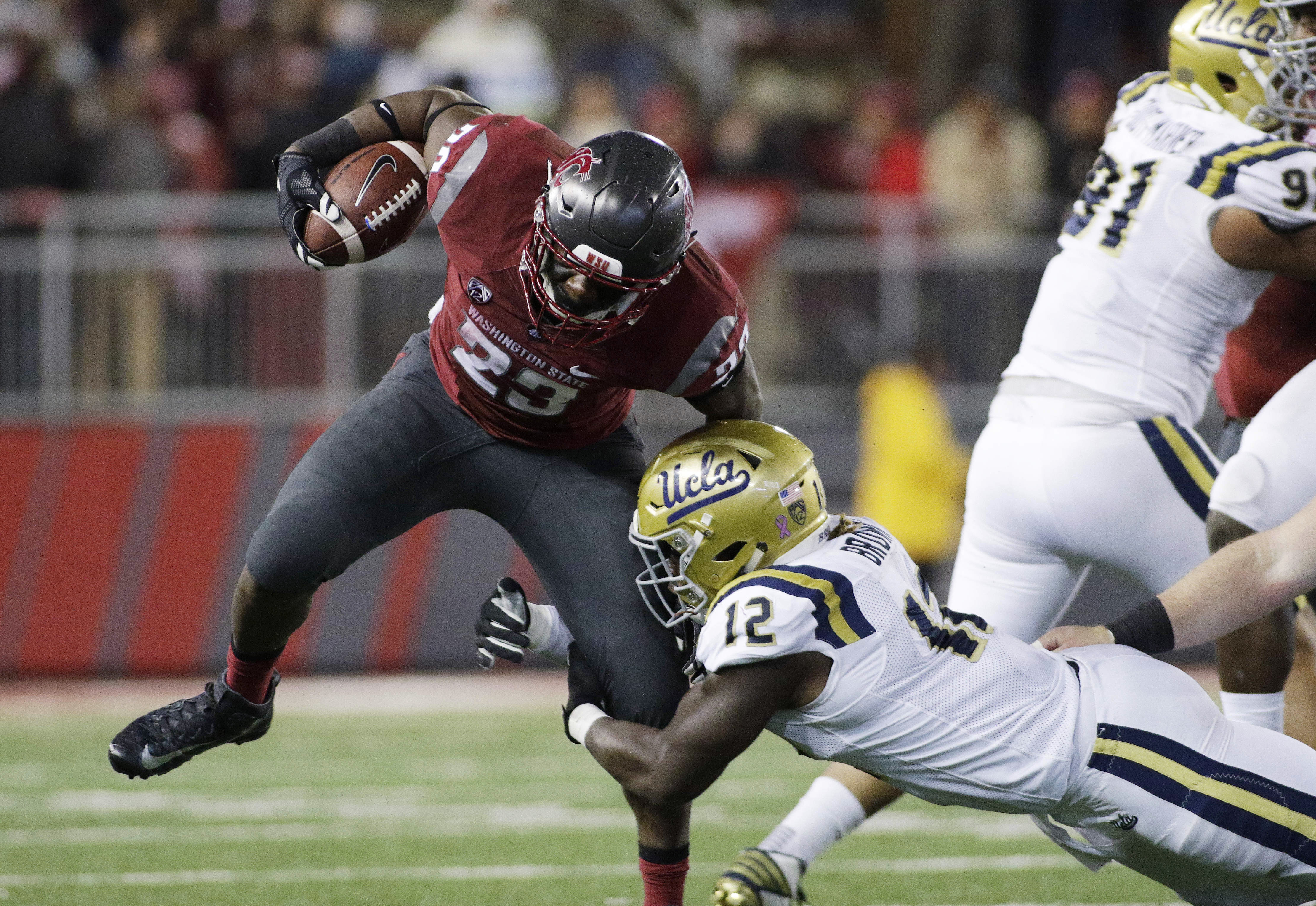 UCLA linebacker Jayon Brown (12) brings down Washington State running back Gerard Wicks (23) during the second half of an NCAA college football game in Pullman, Wash., Saturday, Oct. 15, 2016. Washington State won 27-21. (AP Photo/Young Kwak)