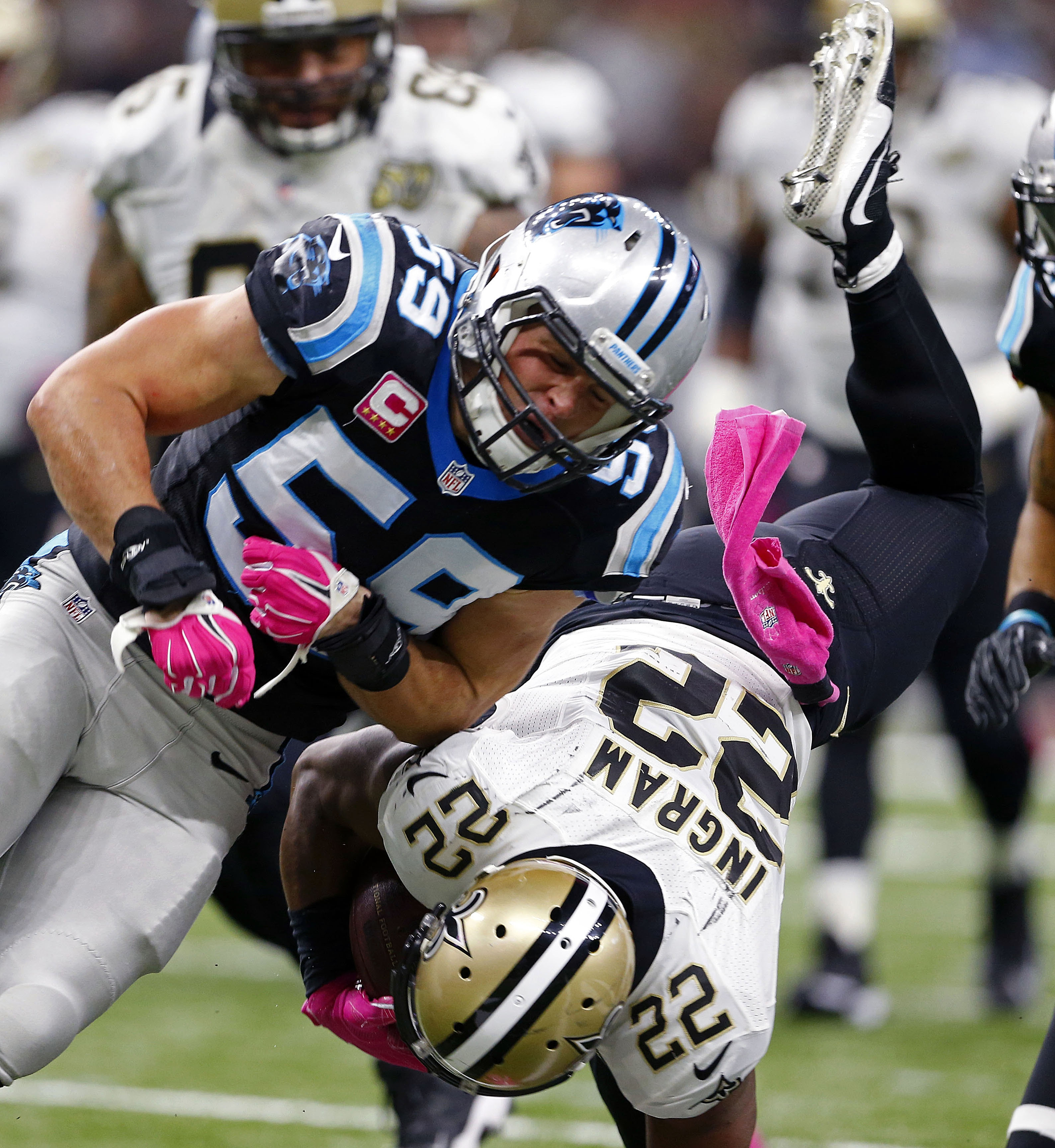 New Orleans Saints running back Mark Ingram (22) is hit by Carolina Panthers middle linebacker Luke Kuechly (59) as he is upended in the first half of an NFL football game in New Orleans, Sunday, Oct. 16, 2016. (AP Photo/Butch Dill)