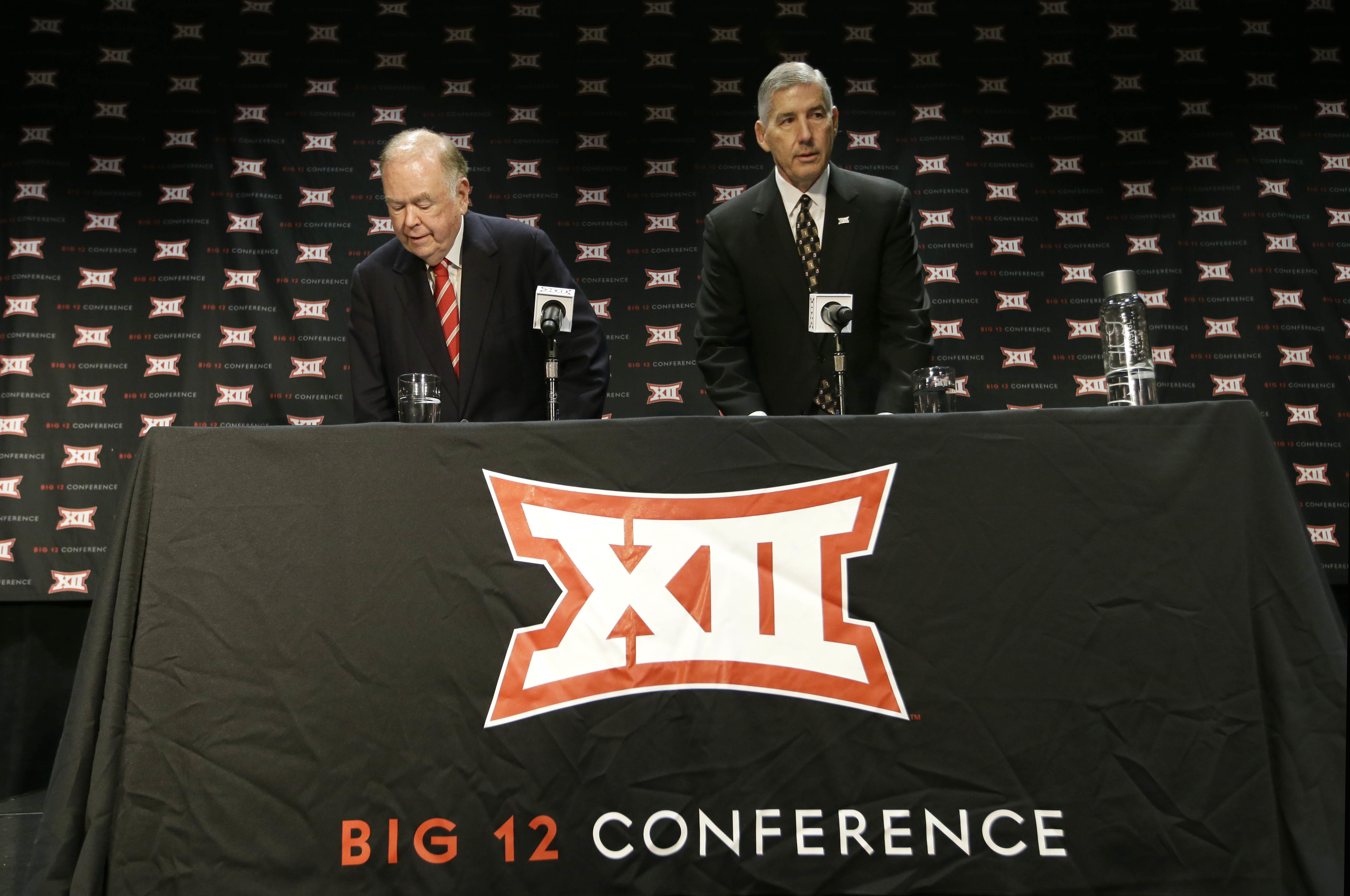 Big 12 Commissioner Bob Bowlsby, right, and Oklahoma President David Boren take their seat to speak to reporter after The Big 12 Conference meeting in Grapevine, Texas, Monday, Oct. 17, 2016. The Big 12 Conference has decided against expansion from its cu