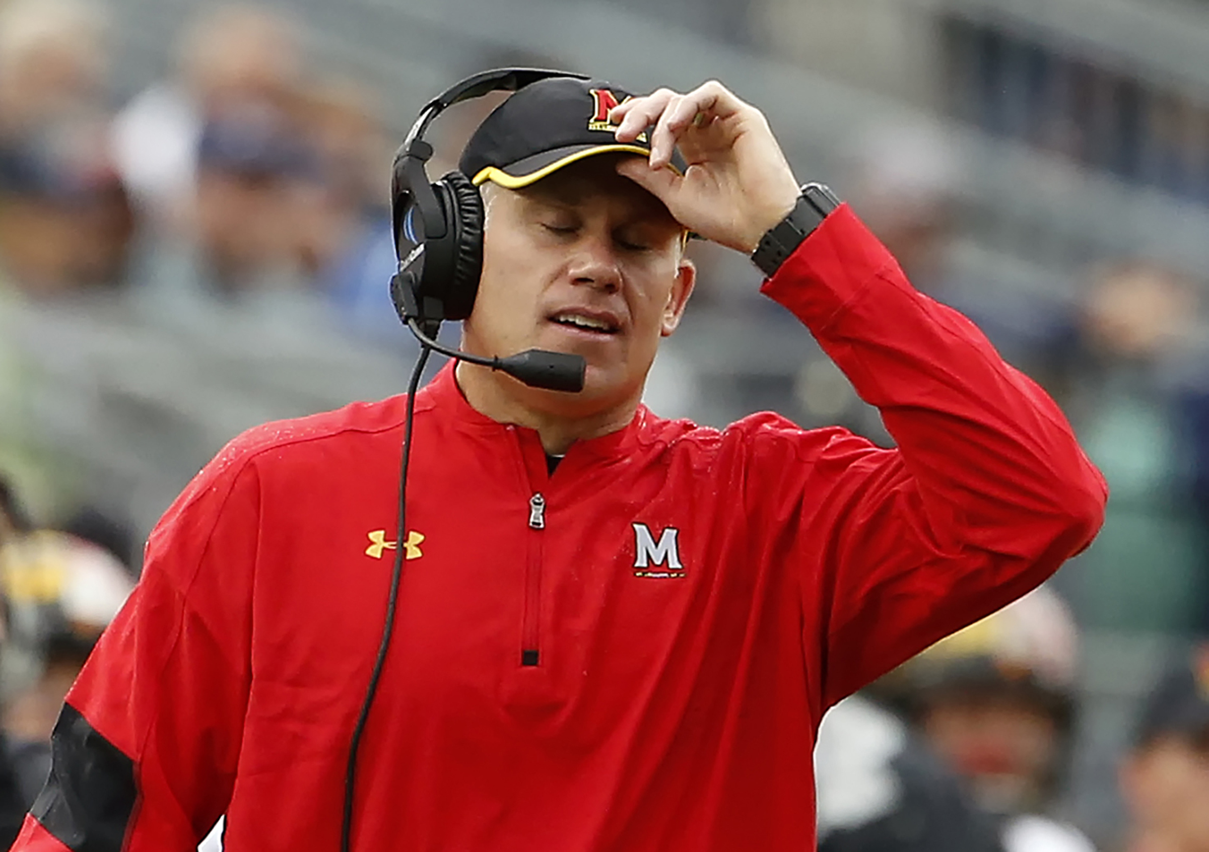 FILE - In this Oct. 8, 2016, file photo, Maryland head coach DJ Durkin reacts after Penn State scores during the second half of an NCAA college football game in State College, Pa. Maryland's offense has sputtered the last two games, and the cure might go