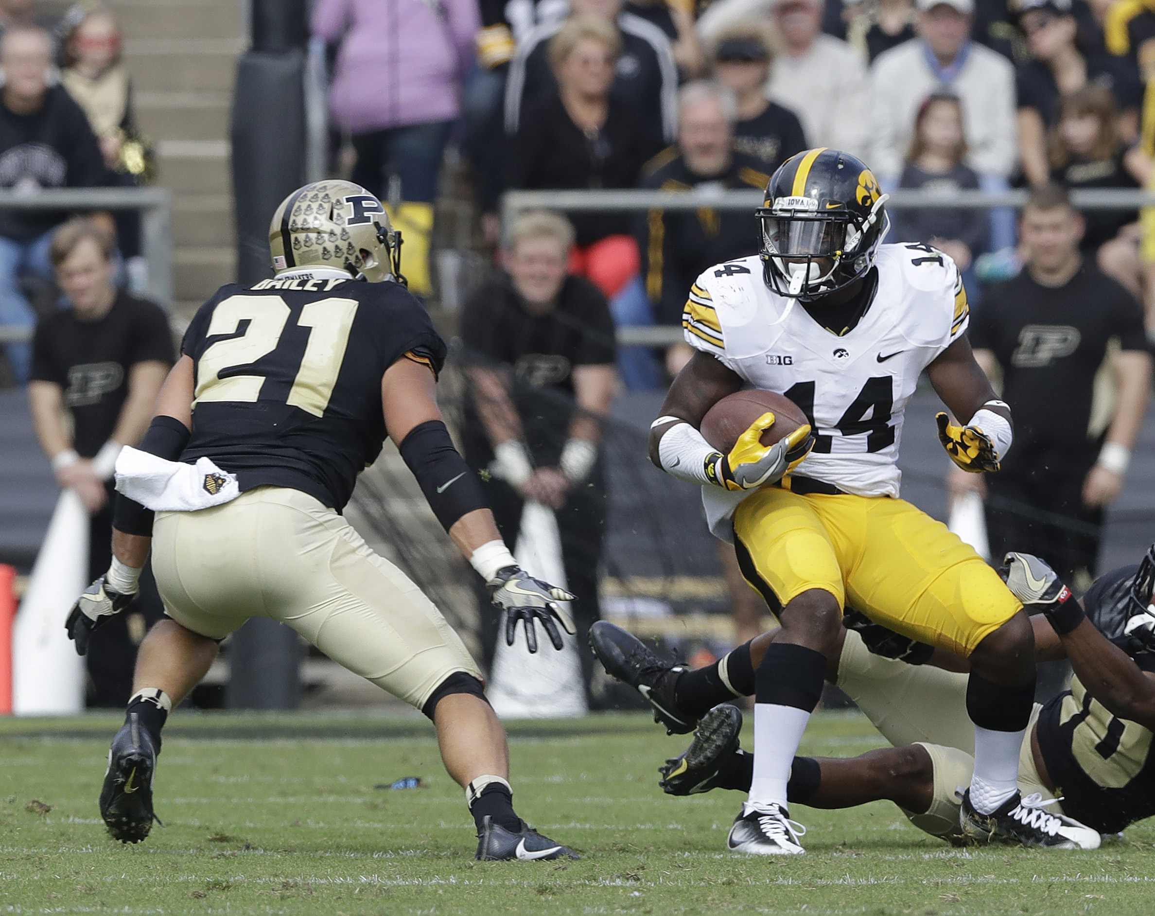 Iowa's Desmond King (14) returns a punt against Purdue's Markus Bailey (21) during the first half of an NCAA college football game, Saturday, Oct. 15, 2016, in West Lafayette, Ind. It's tough to make plays when opposing offenses do everything they can to