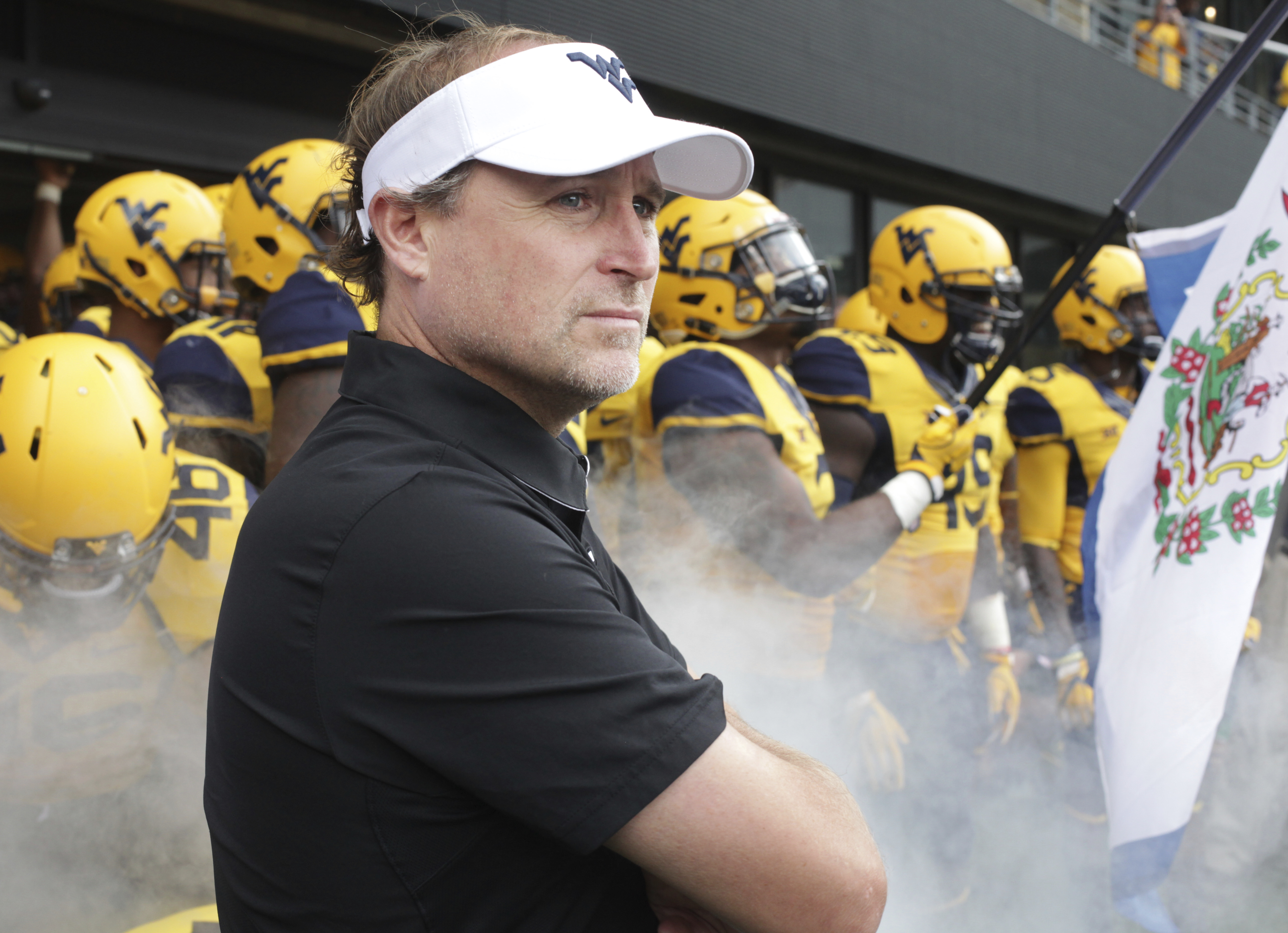 FILE - In this Oct. 1, 2016, file photo, West Virginia head coach Dana Holgorsen waits with his team before an NCAA college football game in Morgantown, W.Va. Holgorsen took plenty of heat for West Virginia's struggles in its first four seasons after join