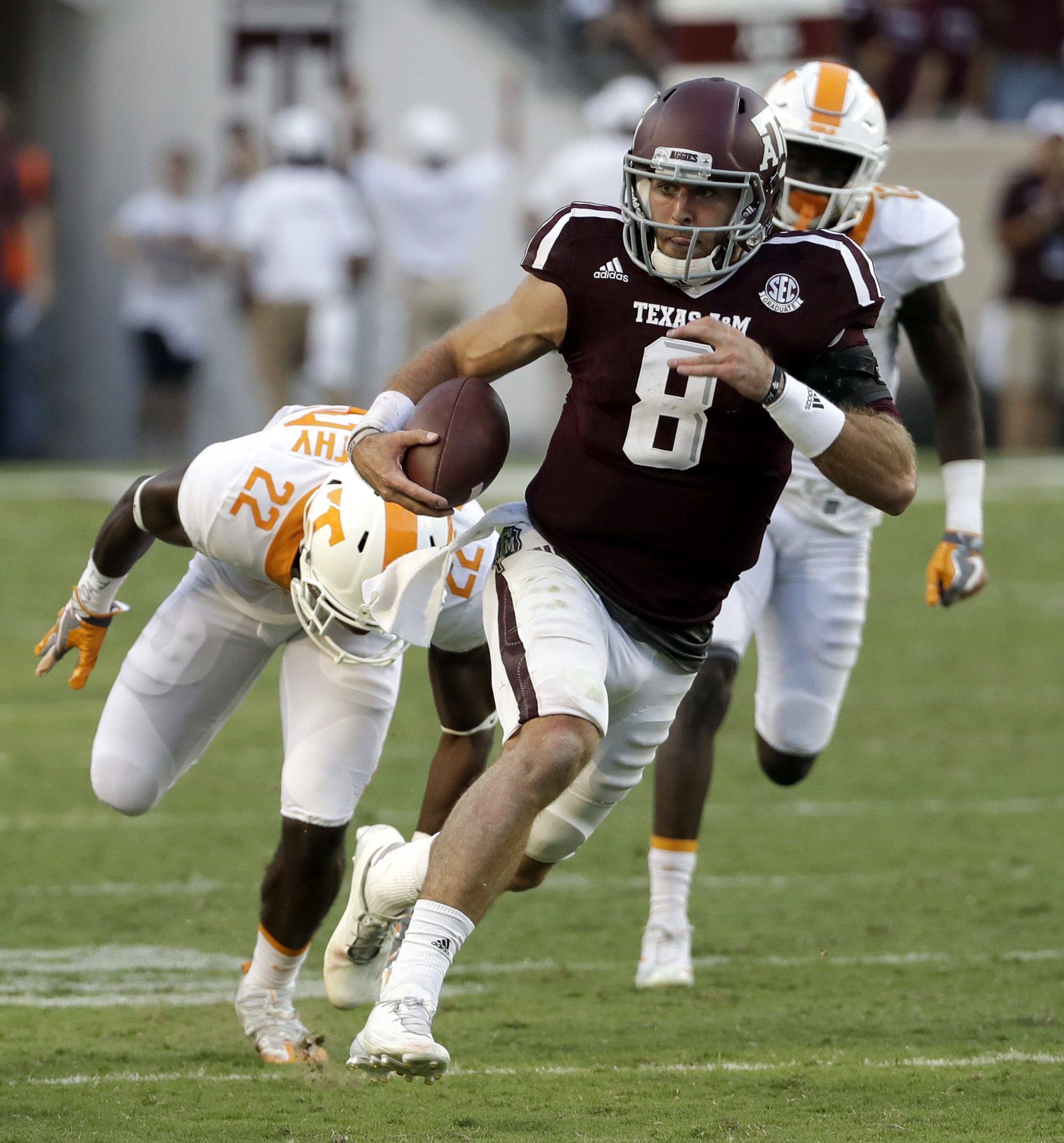 FILE - In this Oct. 8, 2016, file photo, Texas A&M quarterback Trevor Knight (8) rushes for a touchdown past Tennessee defensive back Micah Abernathy during the second half of an NCAA college football game in College Station, Texas. The sixth-ranked Aggie