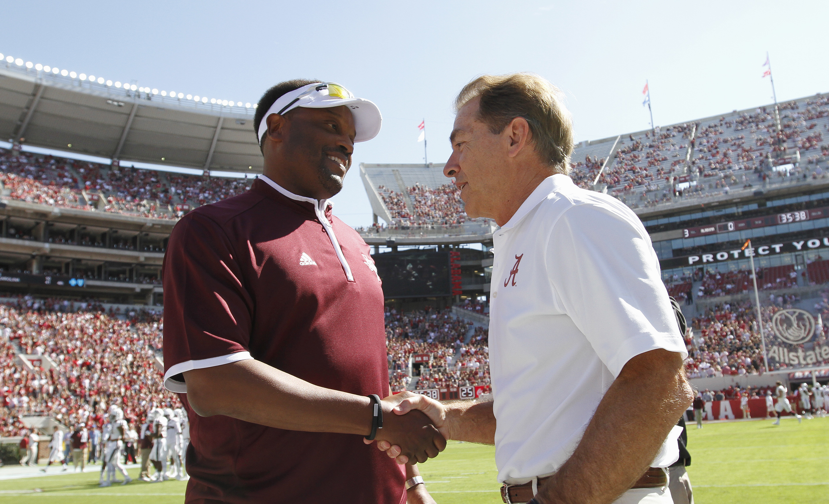 FILE - In this Oct, 18, 2014, file photo, Texas A&M head coach Kevin Sumlin, left, and Alabama head coach Nick Saban shake hands before an NCAA college football game in Tuscaloosa, Ala. The SEC West could be all but decided this Saturday. The leader will