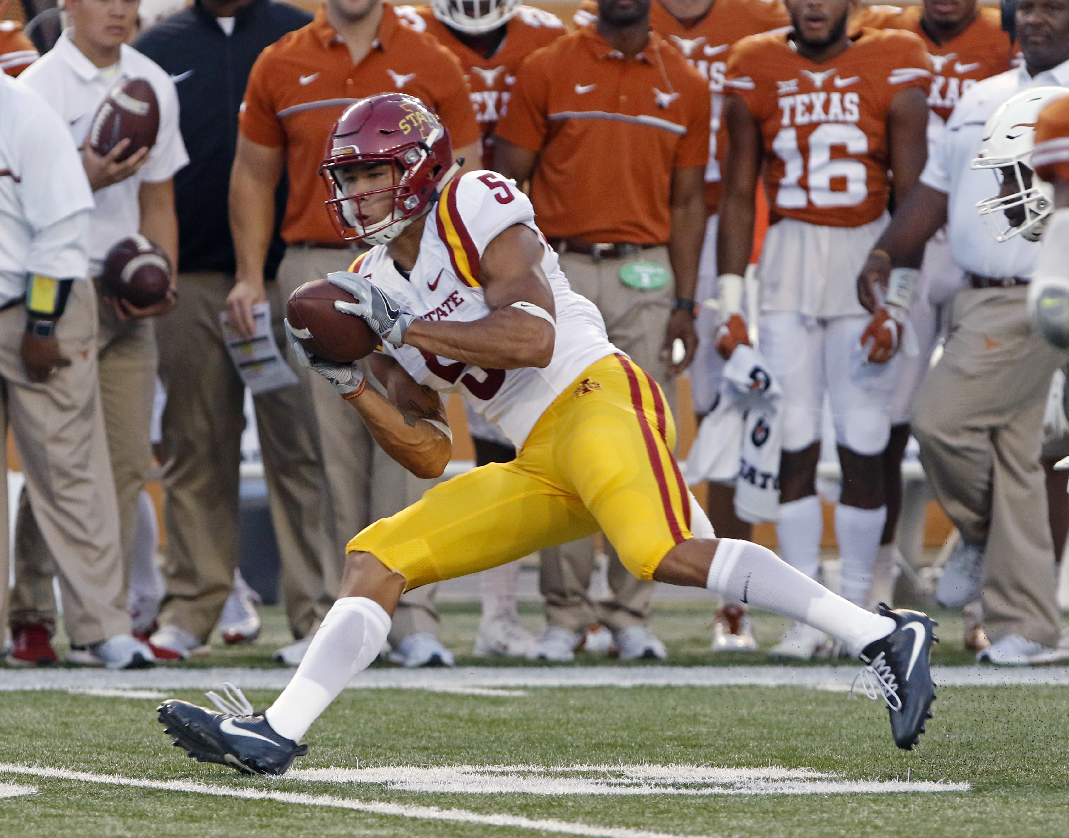 FILE - In this Oct. 15, 2016, file photo, Iowa State's Allen Lazard catches a pass during the team's NCAA college football game against Texa in Austin, Texas. Lazard has a reception in 30 consecutive games, a school record. (AP Photo/Michael Thomas, File)