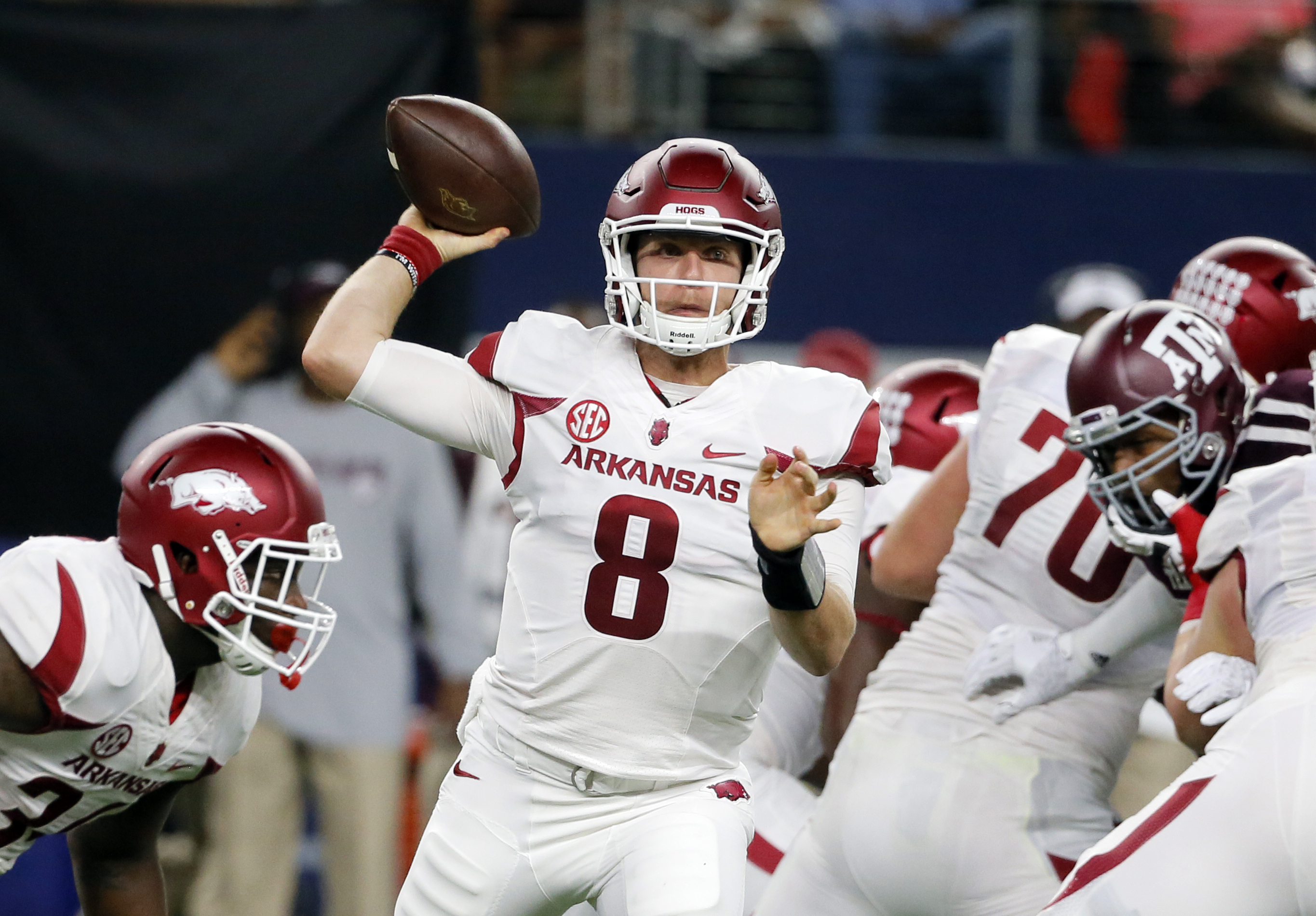 FILE- In this Sept. 24, 2016, file photo, Arkansas quarterback Austin Allen (8) throws a pass during the first half of an NCAA college football game against Texas A&M in Arlington, Texas. Allen has quickly established himself as one of the top quarterback