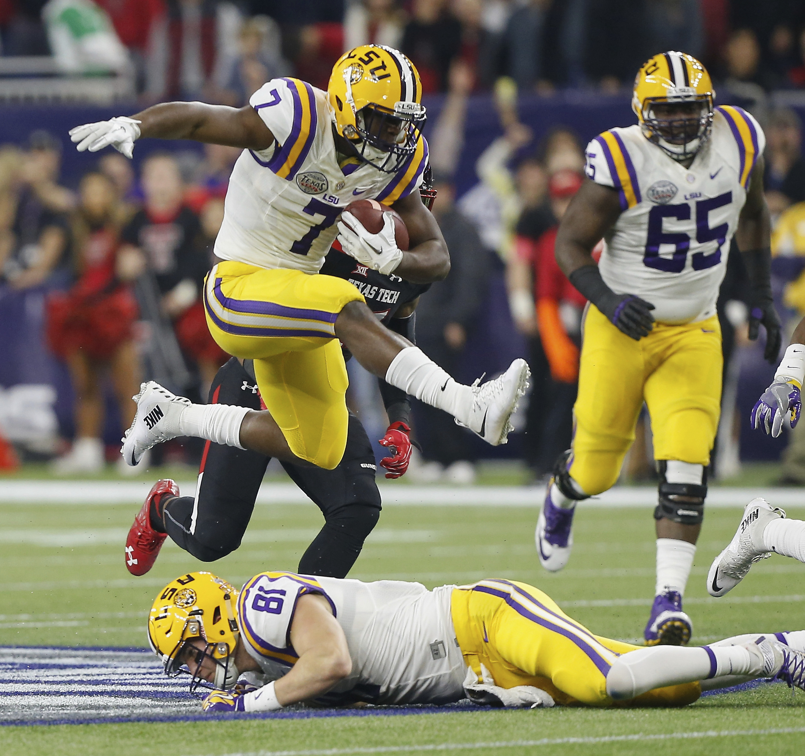 FILE - In this Dec. 29, 2015, file photo, LSU running back Leonard Fournette (7) hurdles tight end Colin Jeter (81) as he rushes against Texas Tech during the first half of the Texas Bowl NCAA college football game in Houston. Lately, the 25th-ranked Tige
