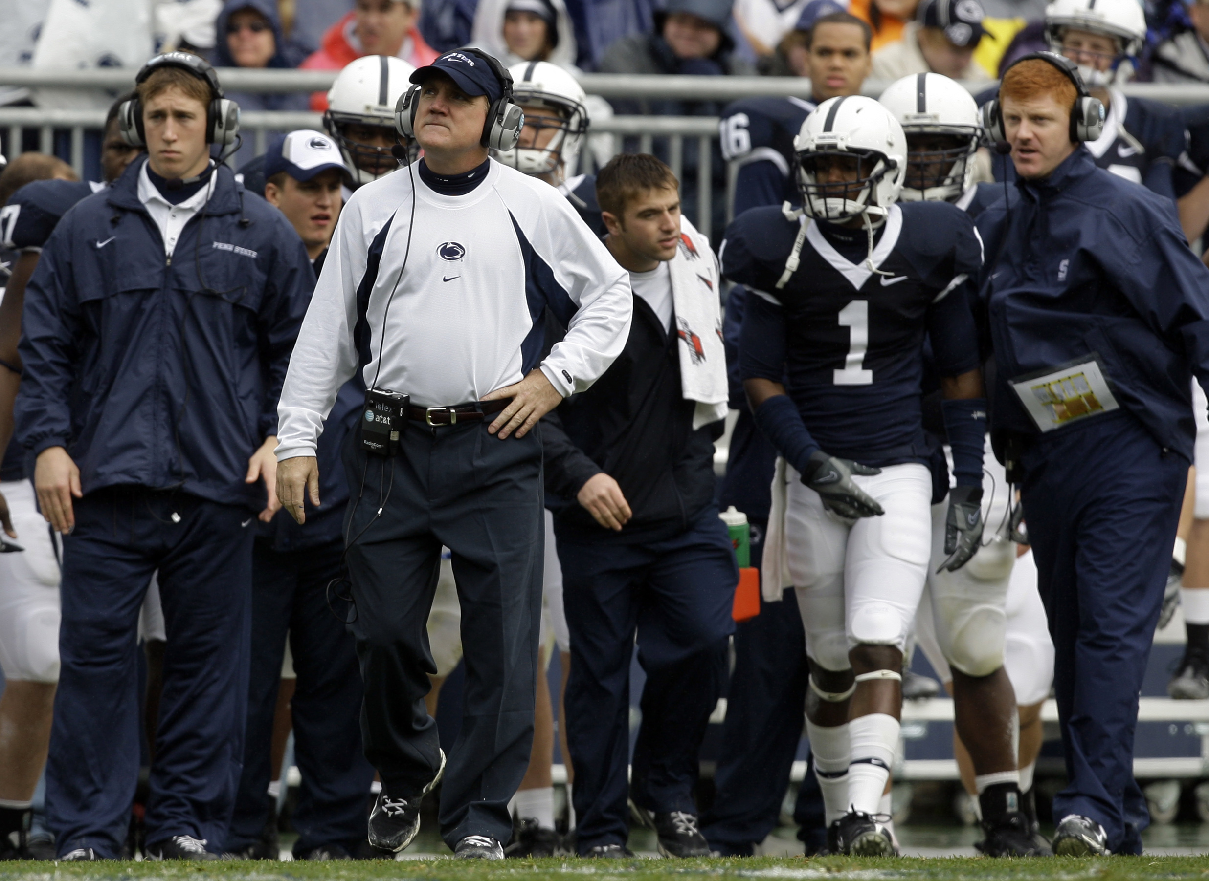 Penn State assistant coach Tom Bradley looks out from the sideline during the first half of their NCAA college football game against Indiana at Beaver Stadium in State College, Pa., Saturday, Nov. 15, 2008. To the far right is assistant coach Mike McQuear