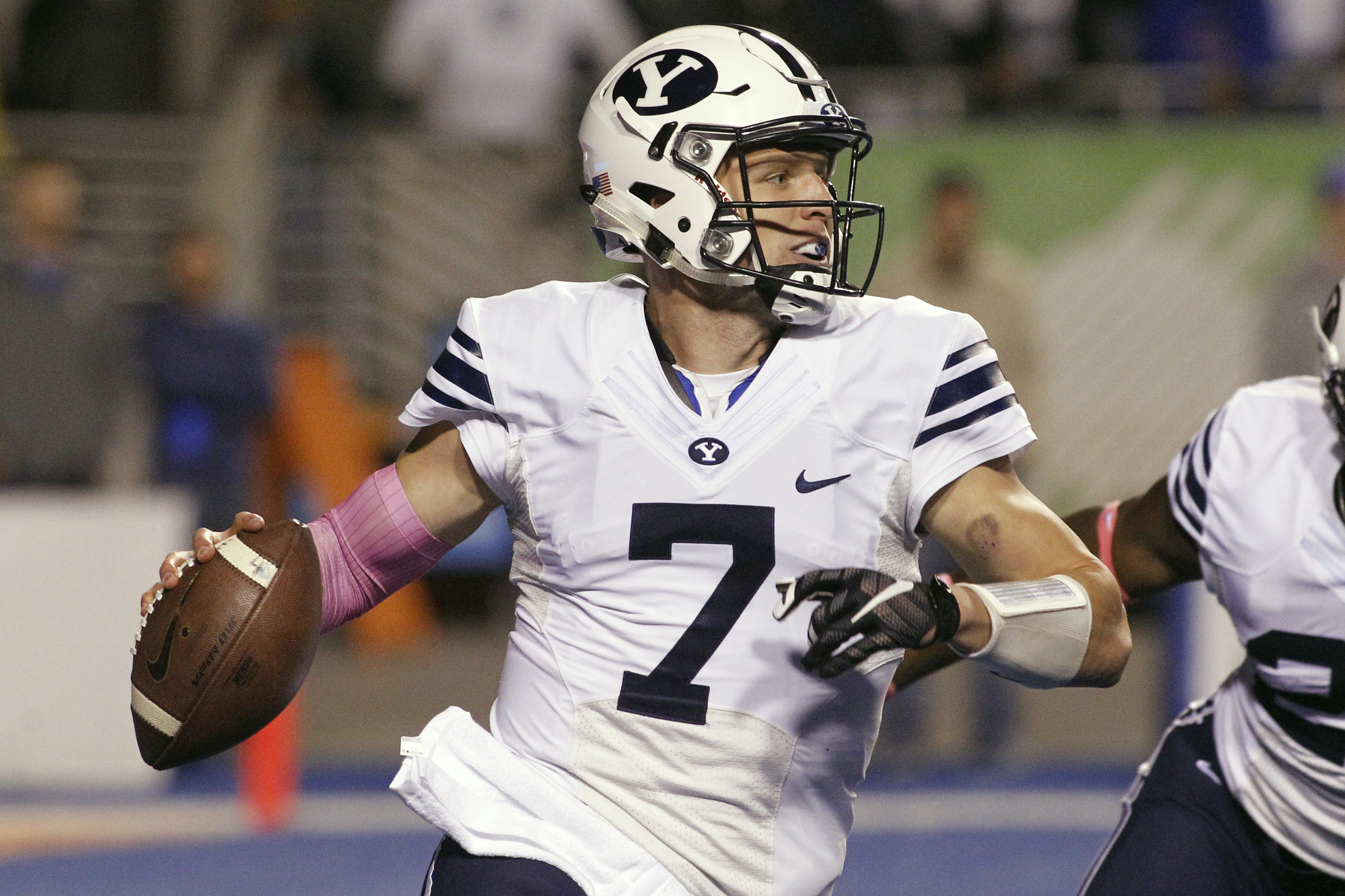 BYU quarterback Taysom Hill looks to pass during the first half of an NCAA college football game against Boise State in Boise, Idaho, Thursday, Oct. 20, 2016. (AP Photo/Otto Kitsinger)