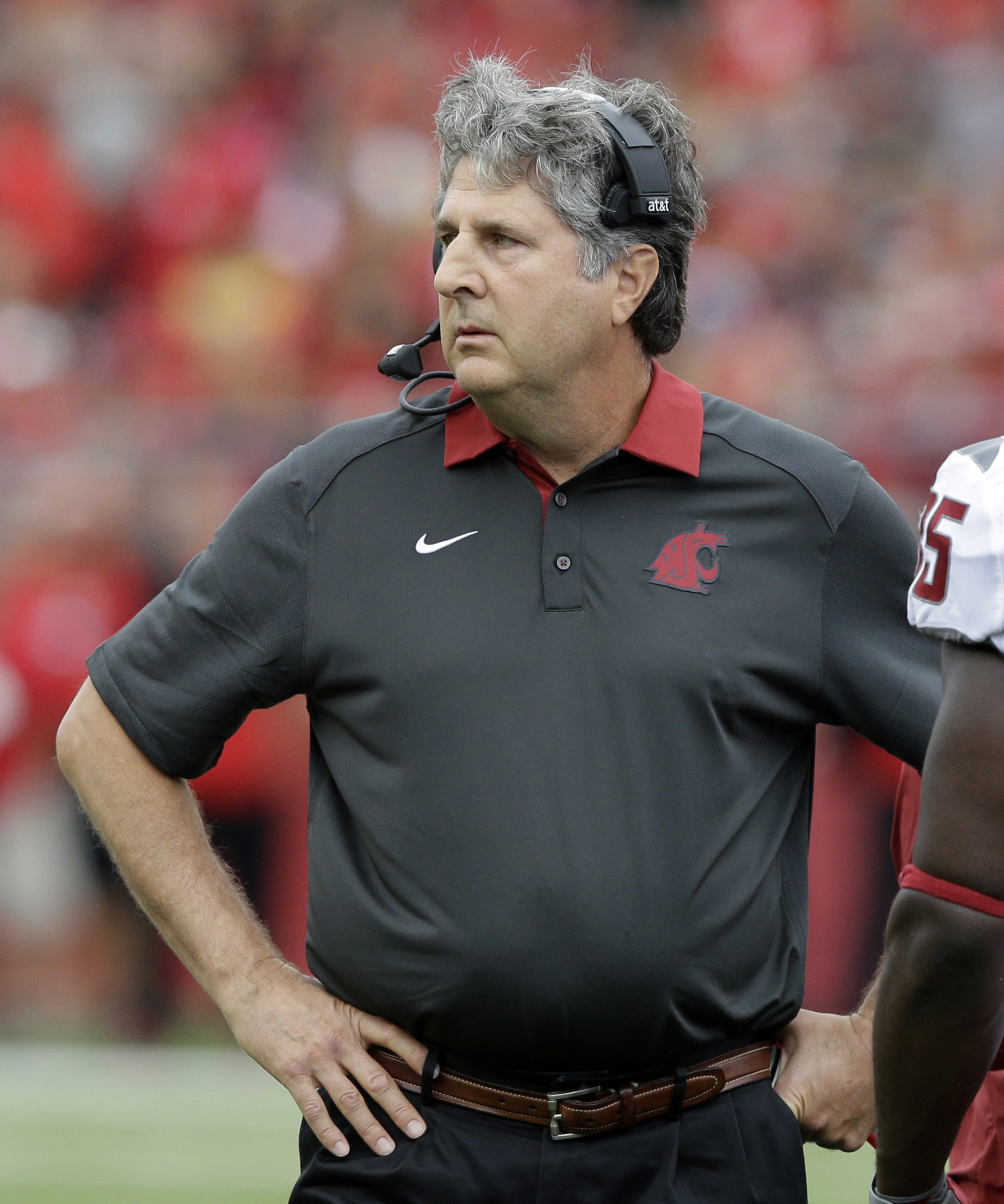 FILE - In this Sept. 12, 2015, file photo, Washington State head coach Mike Leach stands on the sidelines during an NCAA college football game against Rutgers in Piscataway, N.J. Washington State plays at Arizona State on Saturday night.  (AP Photo/Mel Ev