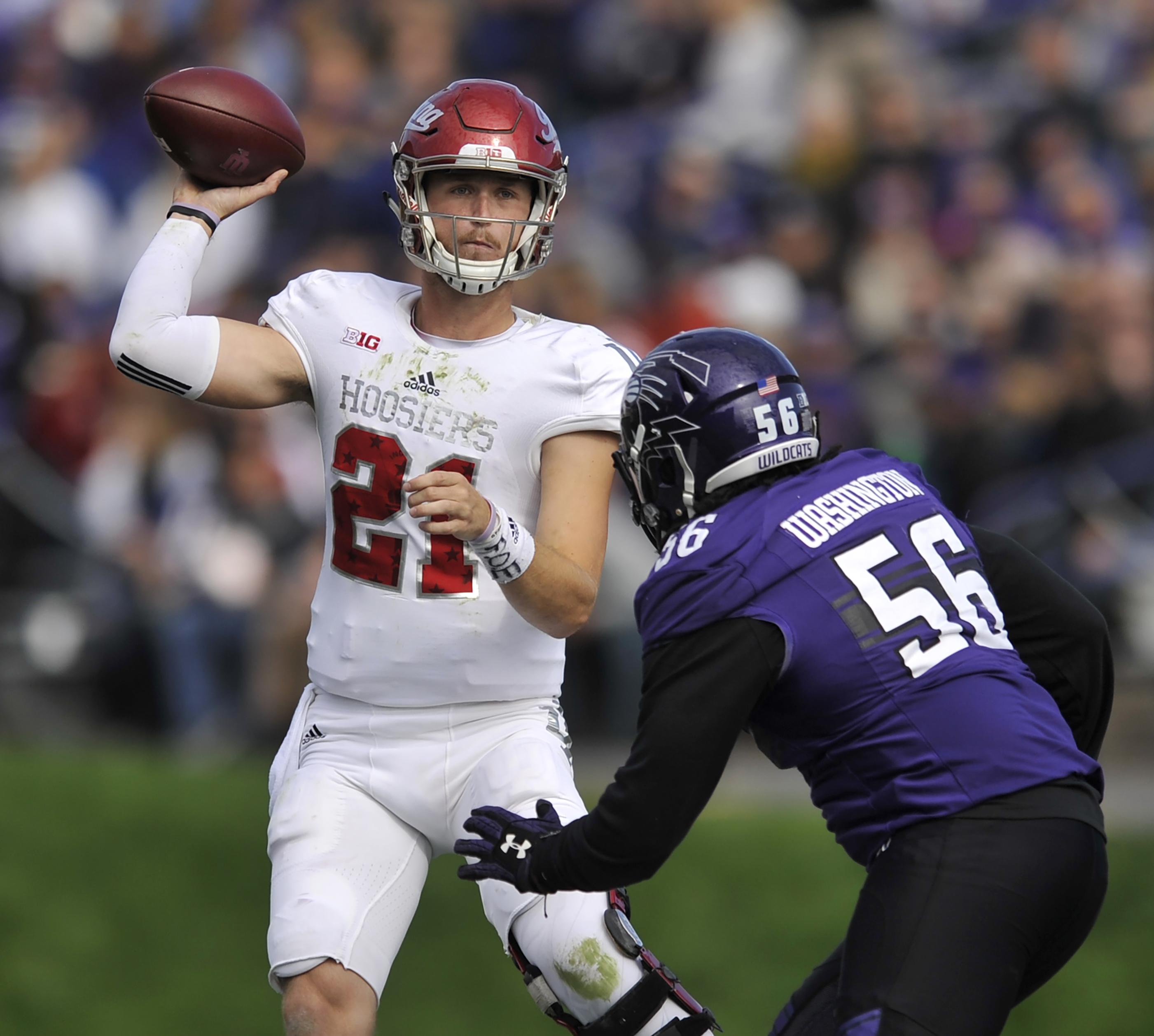 Indiana quarterback Richard Lagow (21) throws a pass against Northwestern's Xavier Washington (56) during the third quarter of an NCAA college football game Saturday, Oct. 22, 2016, in Evanston, Ill. (AP Photo/Paul Beaty)