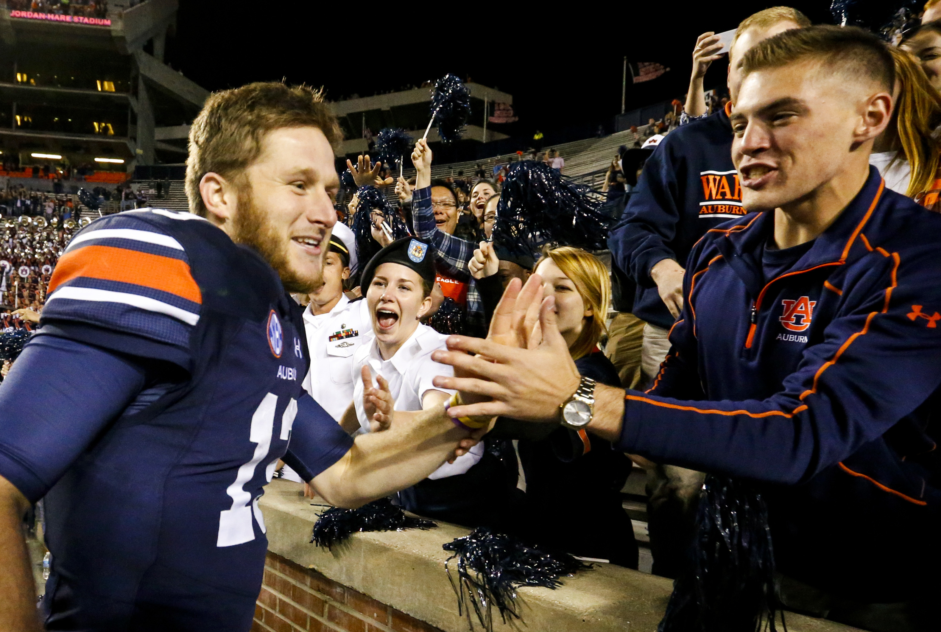 Auburn quarterback Sean White (13) celebrates with fans after they defeated Arkansas 56-3 in an NCAA college football game, Saturday, Oct. 22, 2016, in Auburn, Ala. (AP Photo/Butch Dill)