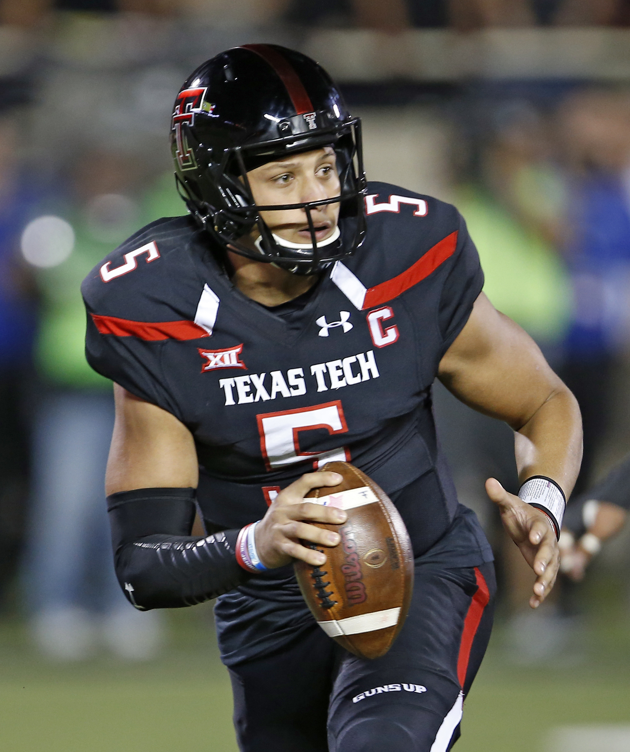 Texas Tech's Patrick Mahomes (5) looks to pass the ball during an NCAA college football game against Oklahoma, Saturday, Oct. 22, 2016, in Lubbock, Texas. (Brad Tollefson/Lubbock Avalanche-Journal via AP)
